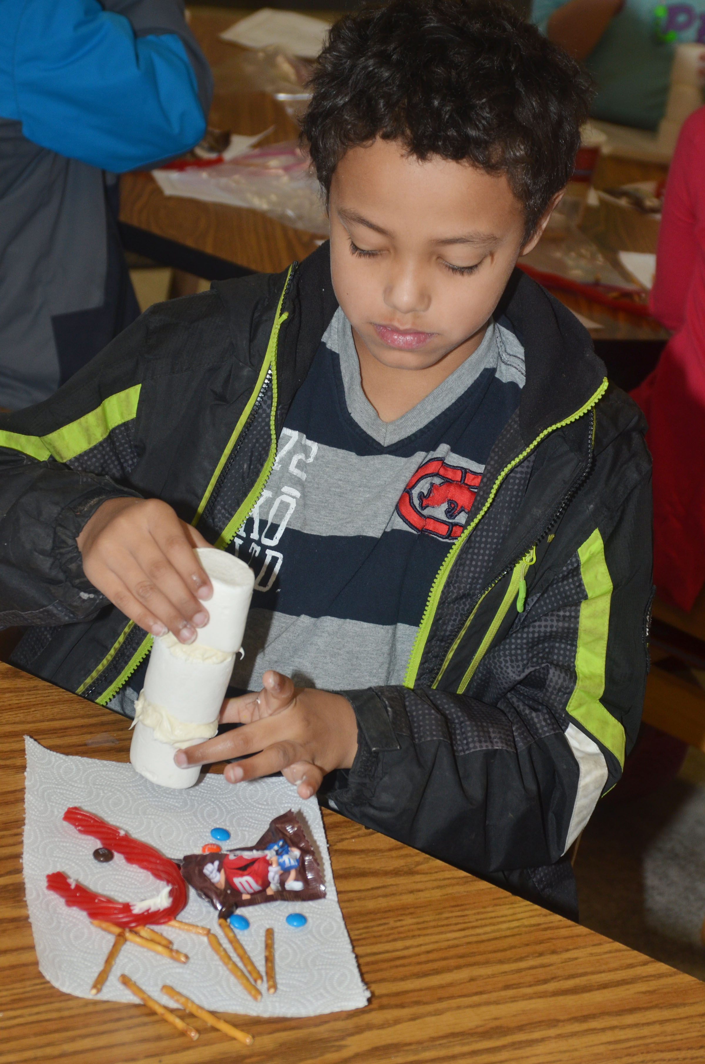 CES third-grader Chance Owens builds his edible snowman.