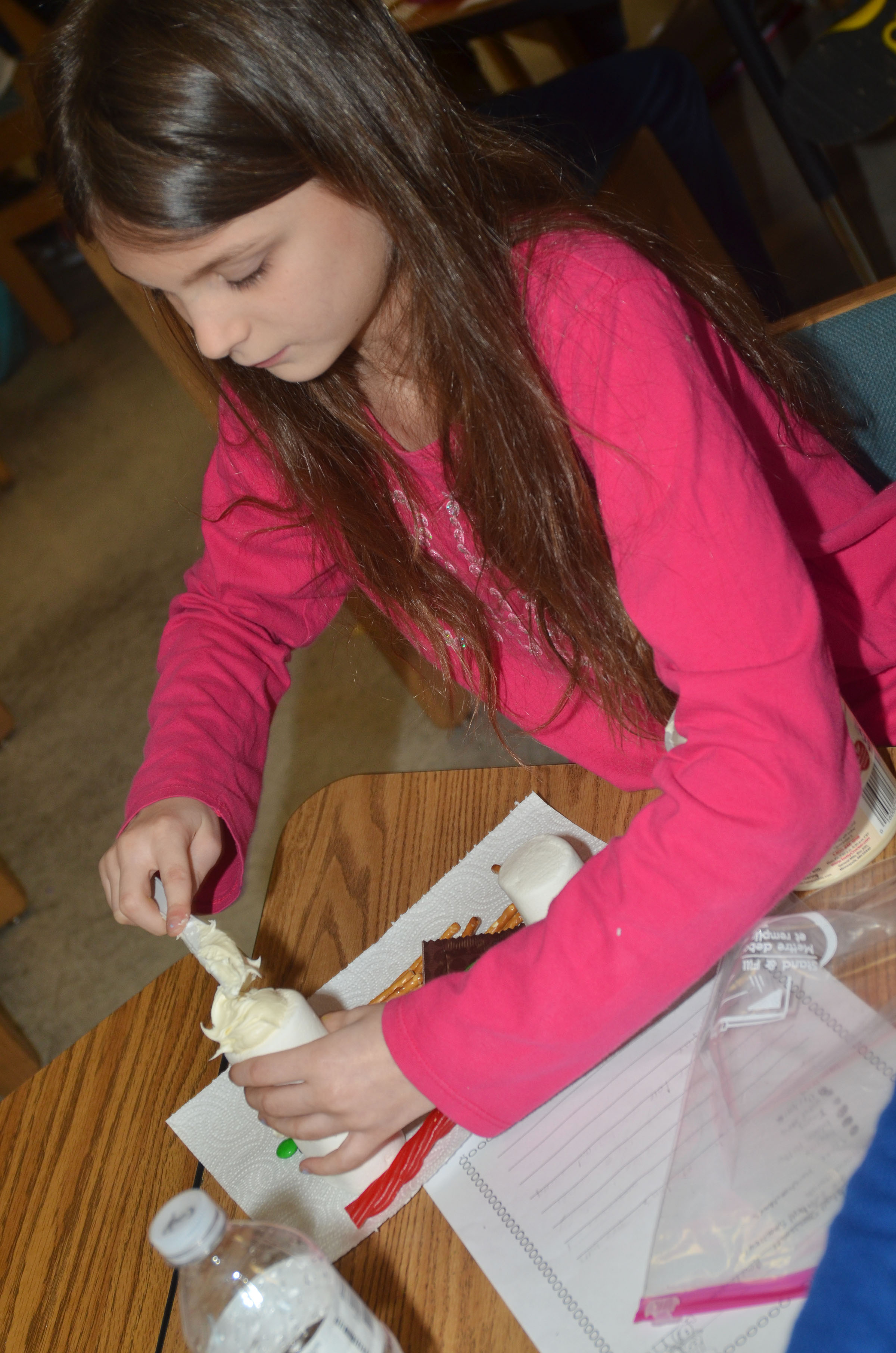 CES third-grader Madie Gebler adds icing to her marshmallows.