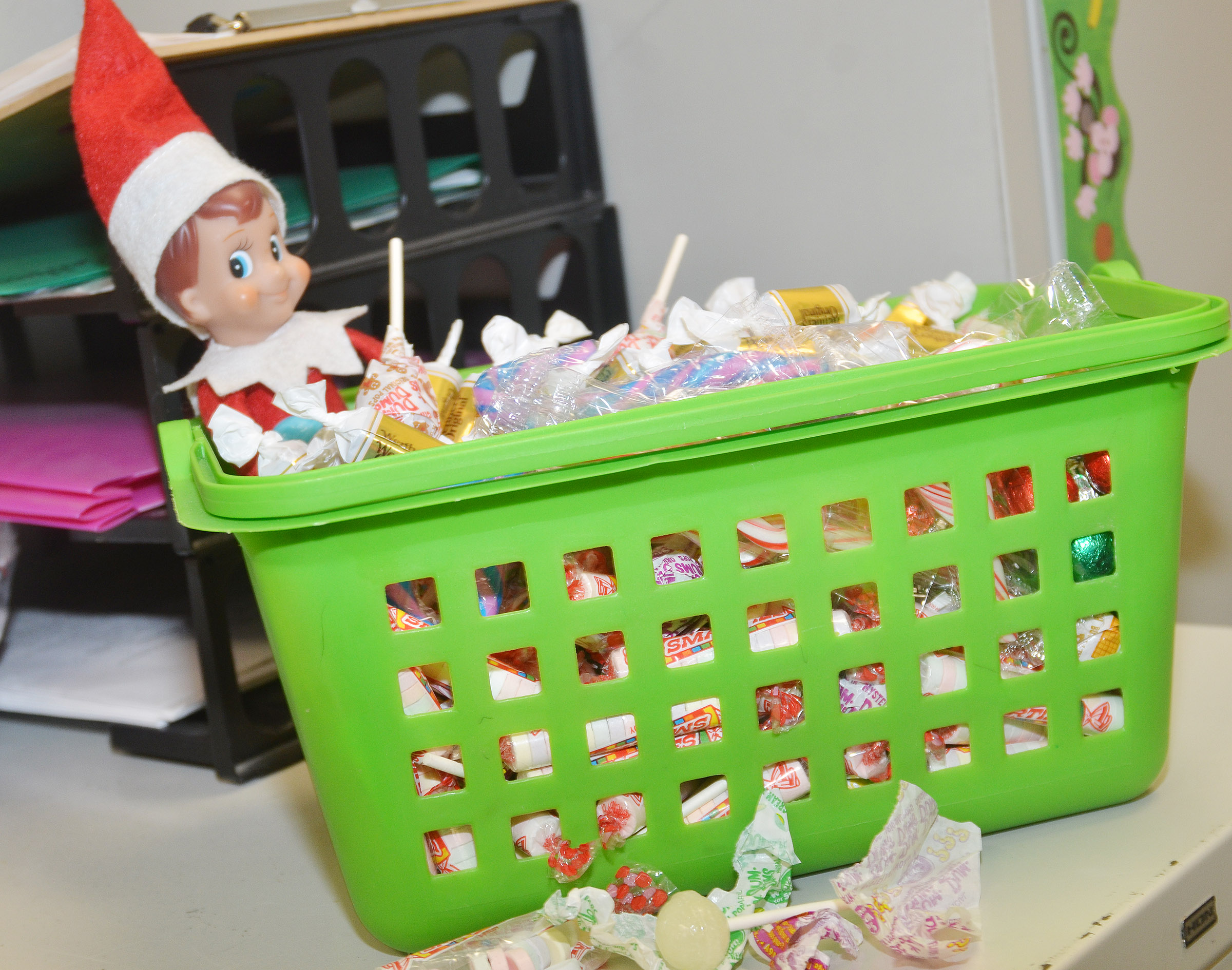 Elves recently created some messes at CES. This elf helped himself to a classroom candy basket.