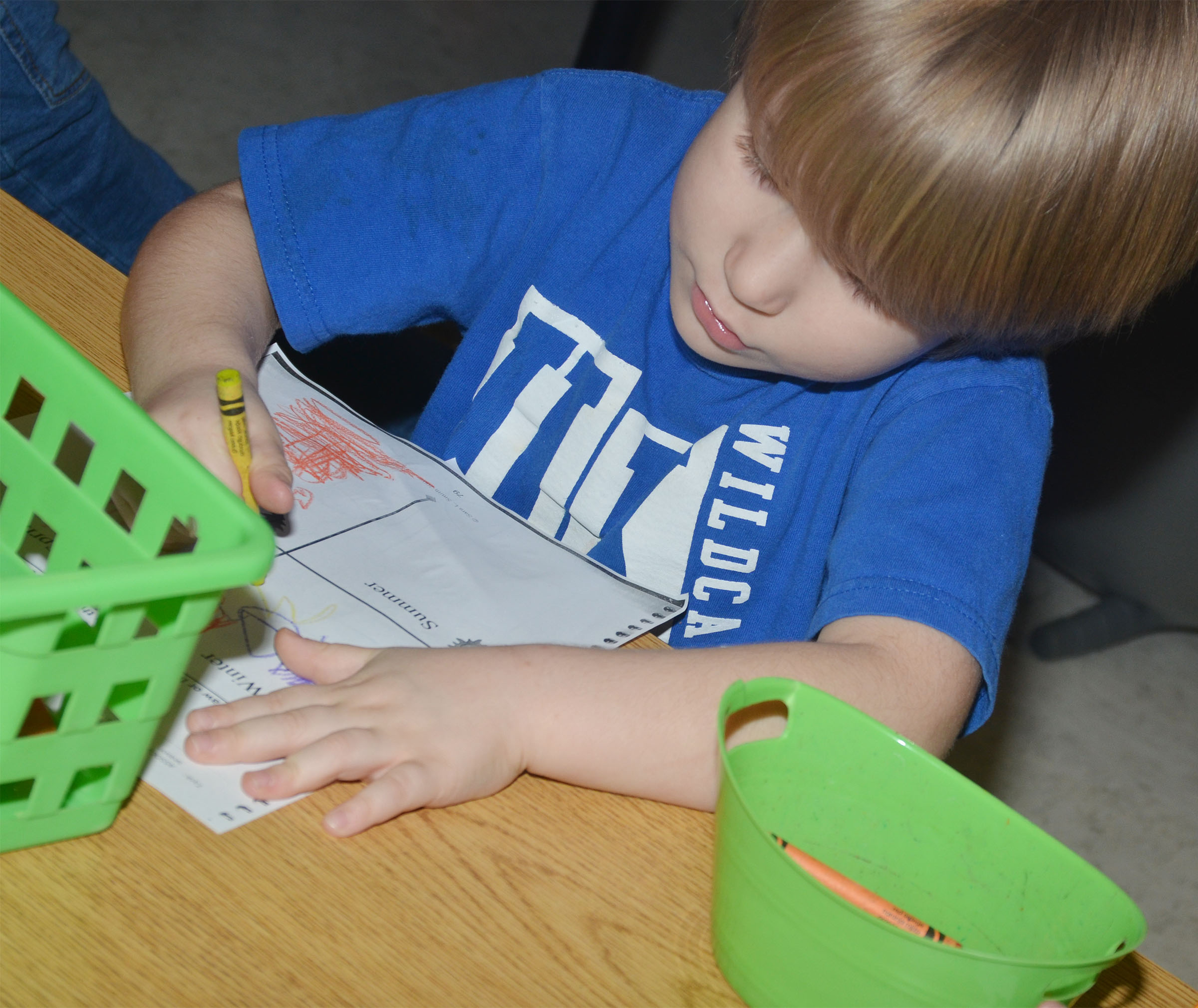 CES kindergartener Luke Banta colors his worksheet.