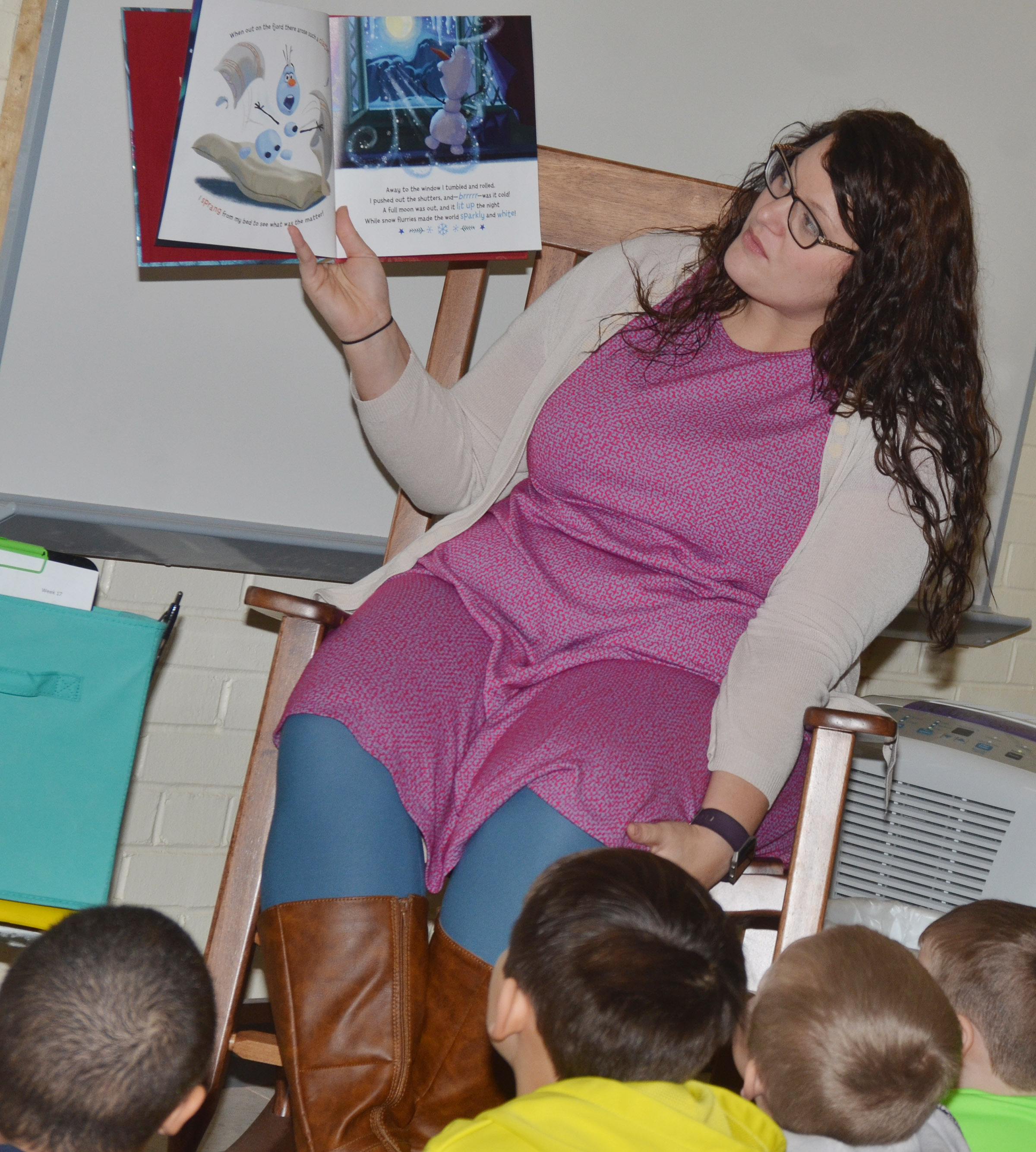 "CES Explorers teacher Miriah Cox reads ""Olaf's Night Before Christmas."""