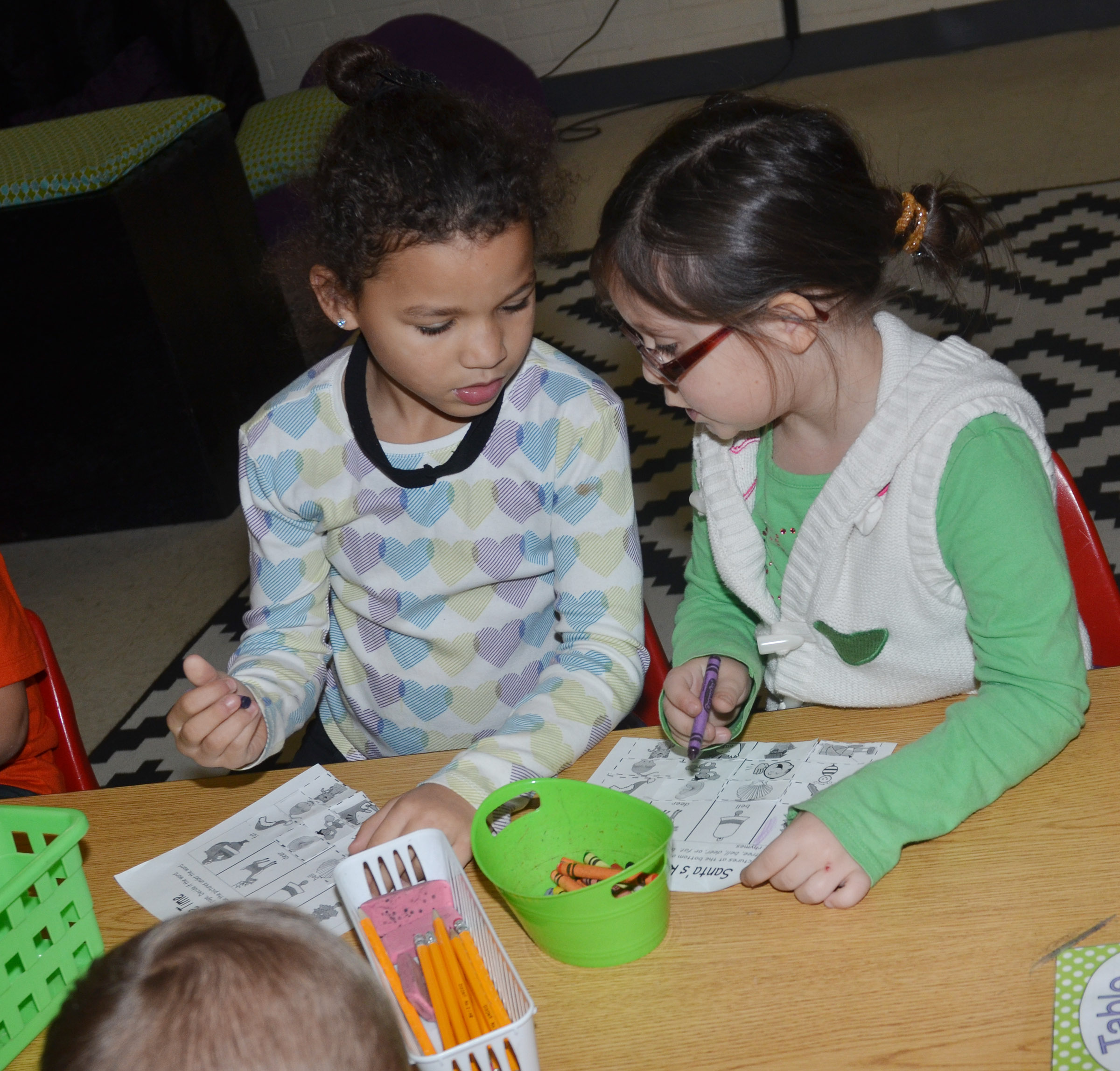 CES kindergarteners Aleeya Spaulding, at left, and Trinity Clark talk about their rhyming words.