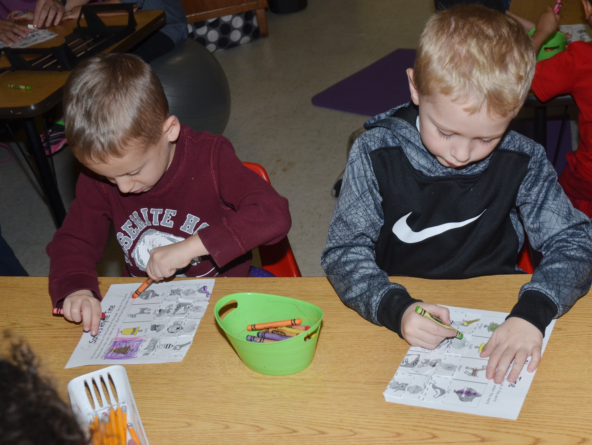 CES kindergarteners Gavin Paris, at left, and Jackson Wright color their pictures after learning their rhyming words.