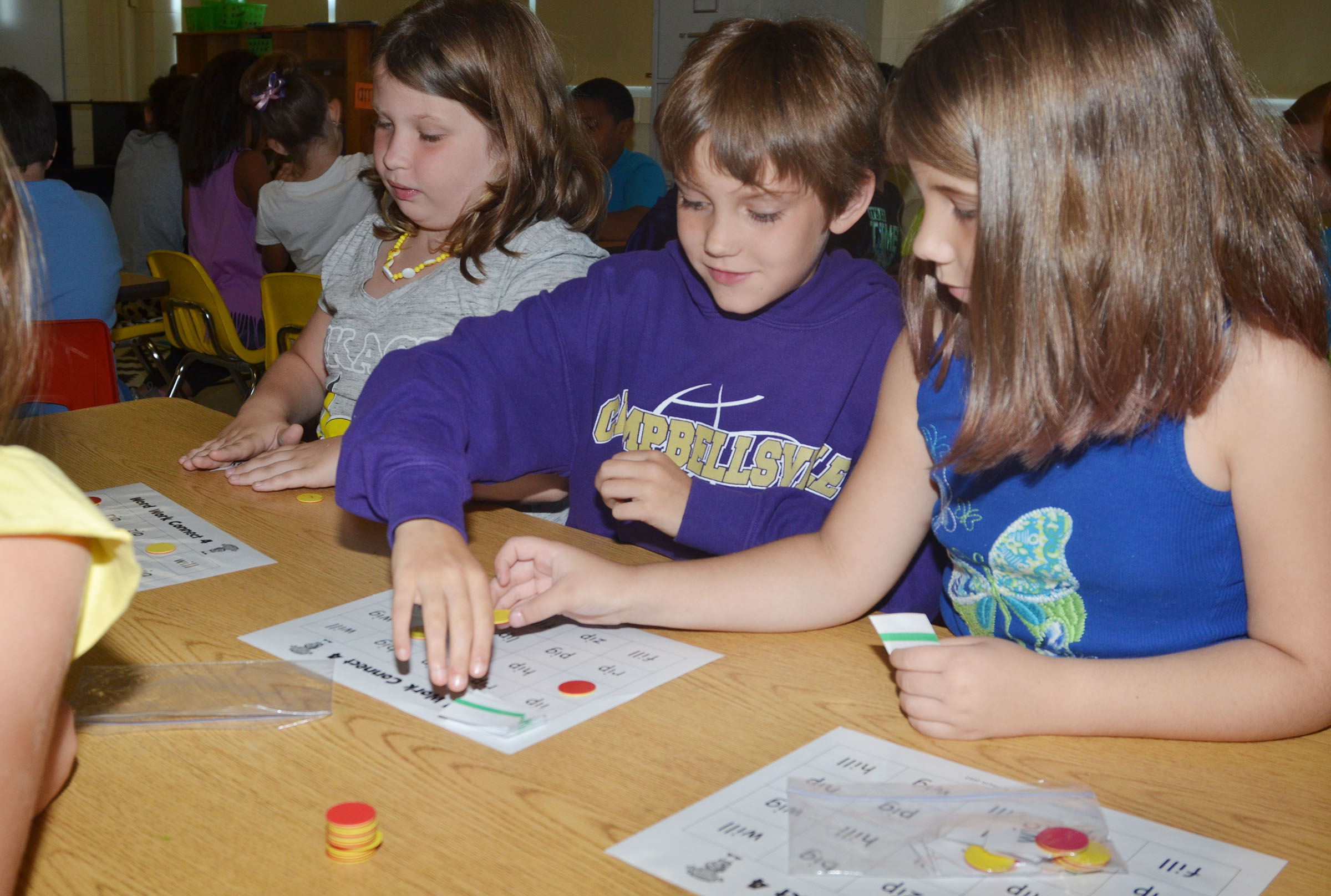CES second-graders, from left, Amory Denham, Baylee Pike and Natalia West play Connect 4 with sight words.