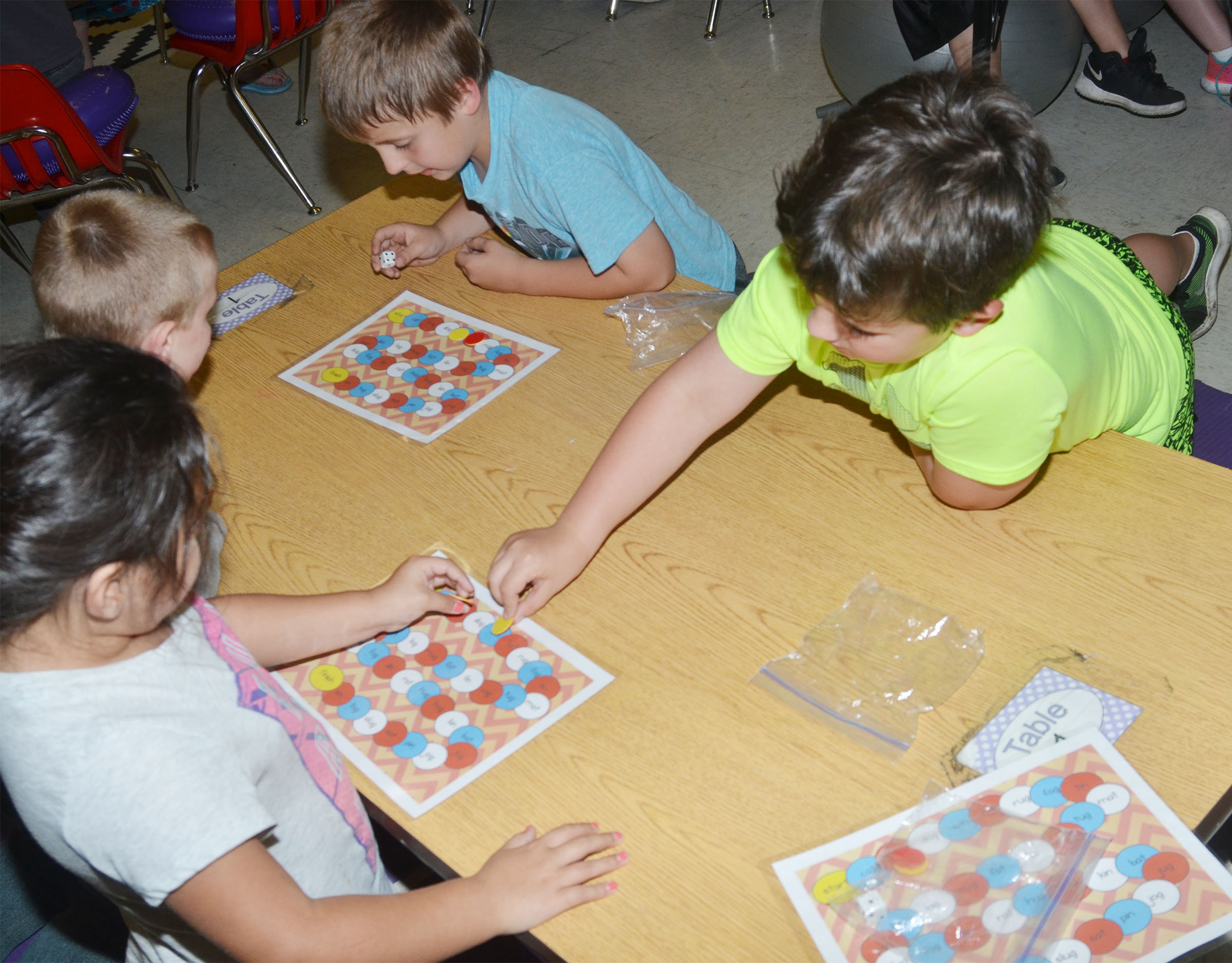 CES kindergartener Casen Meredith plays a sight word game with his friends.