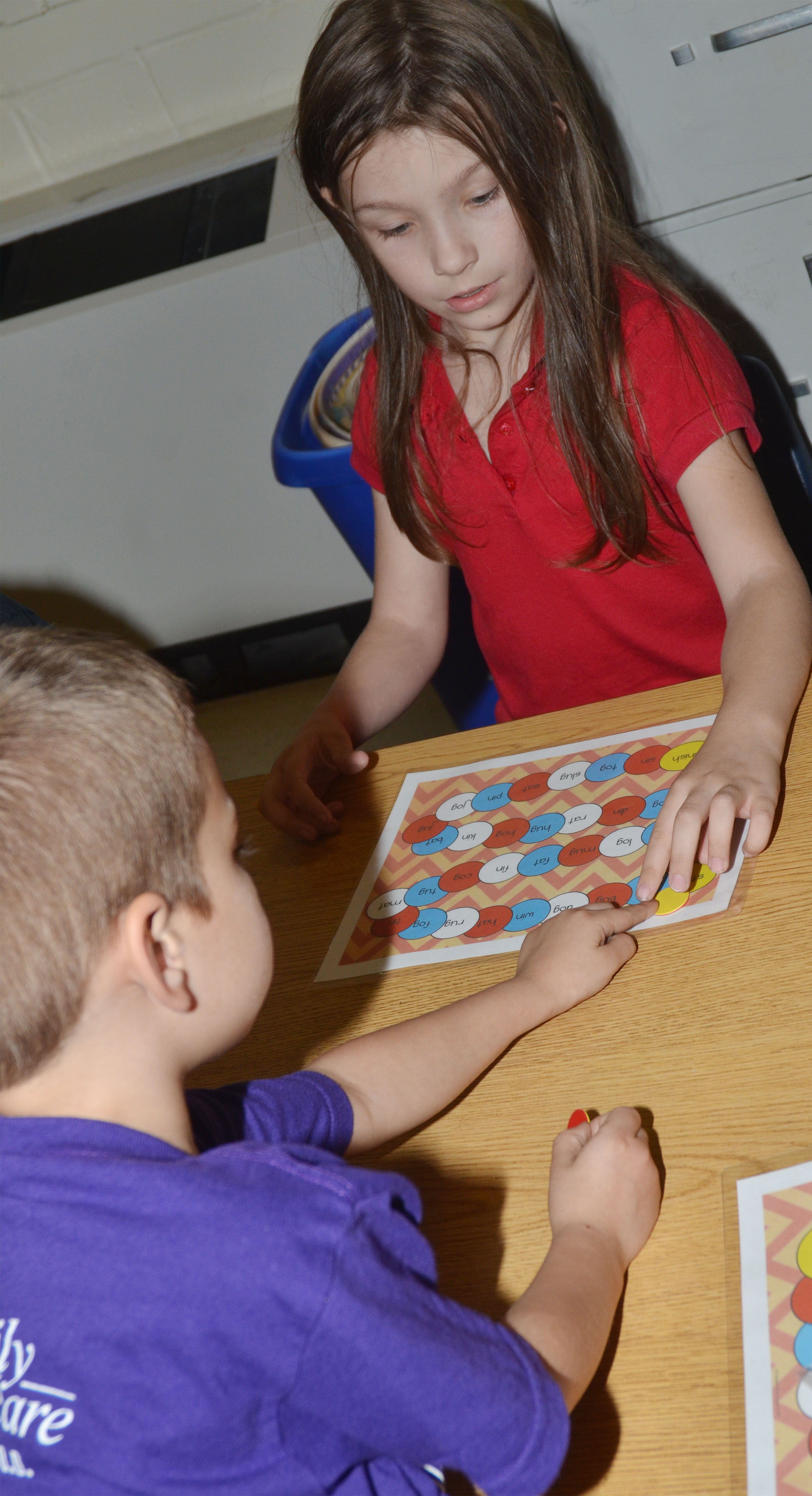 CES kindergartener Melody Ward plays a sight word game with her friends.