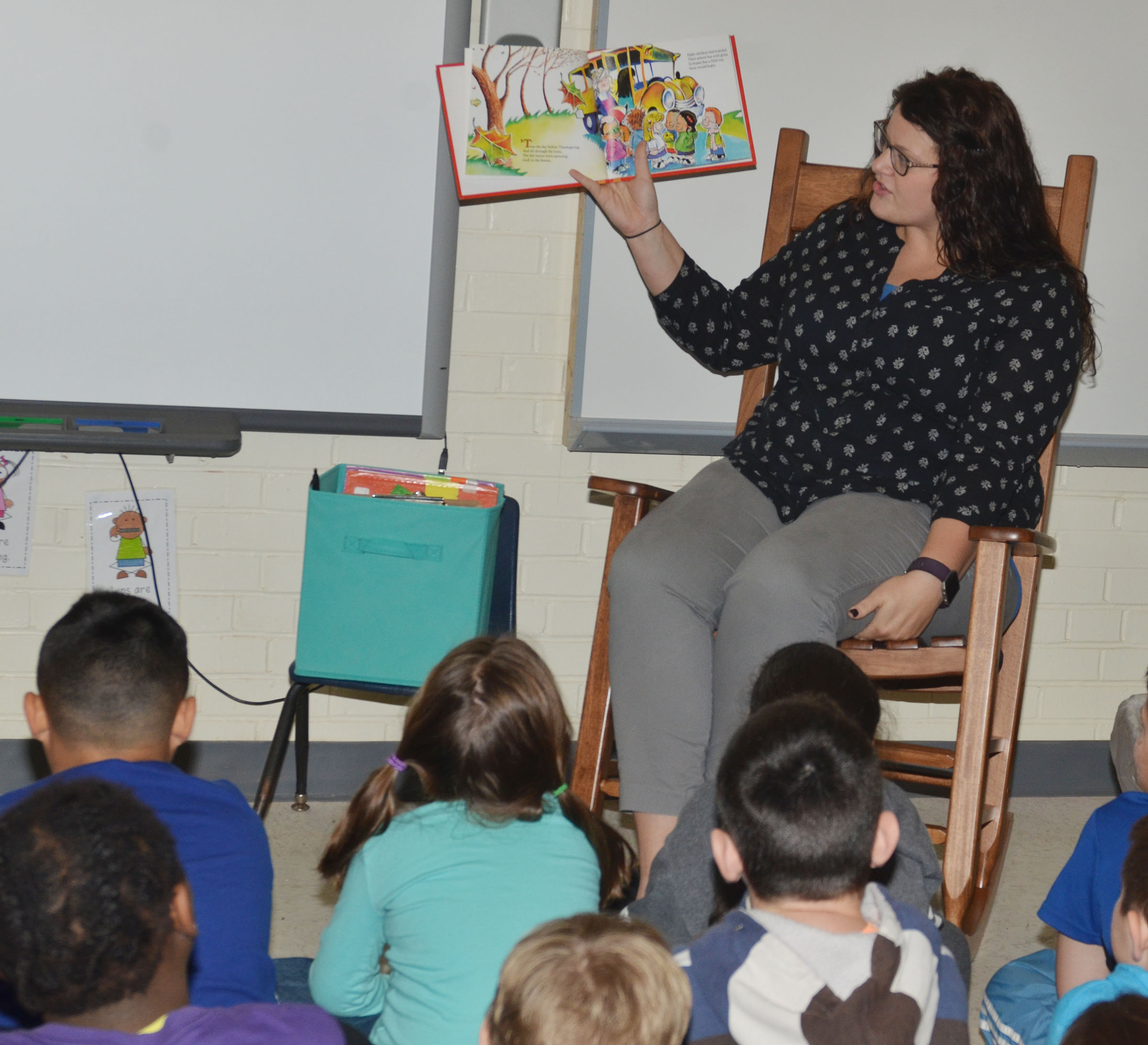 "CES Explorers teacher Miriah Cox reads ""'Twas the Night Before Thanksgiving"" to students."