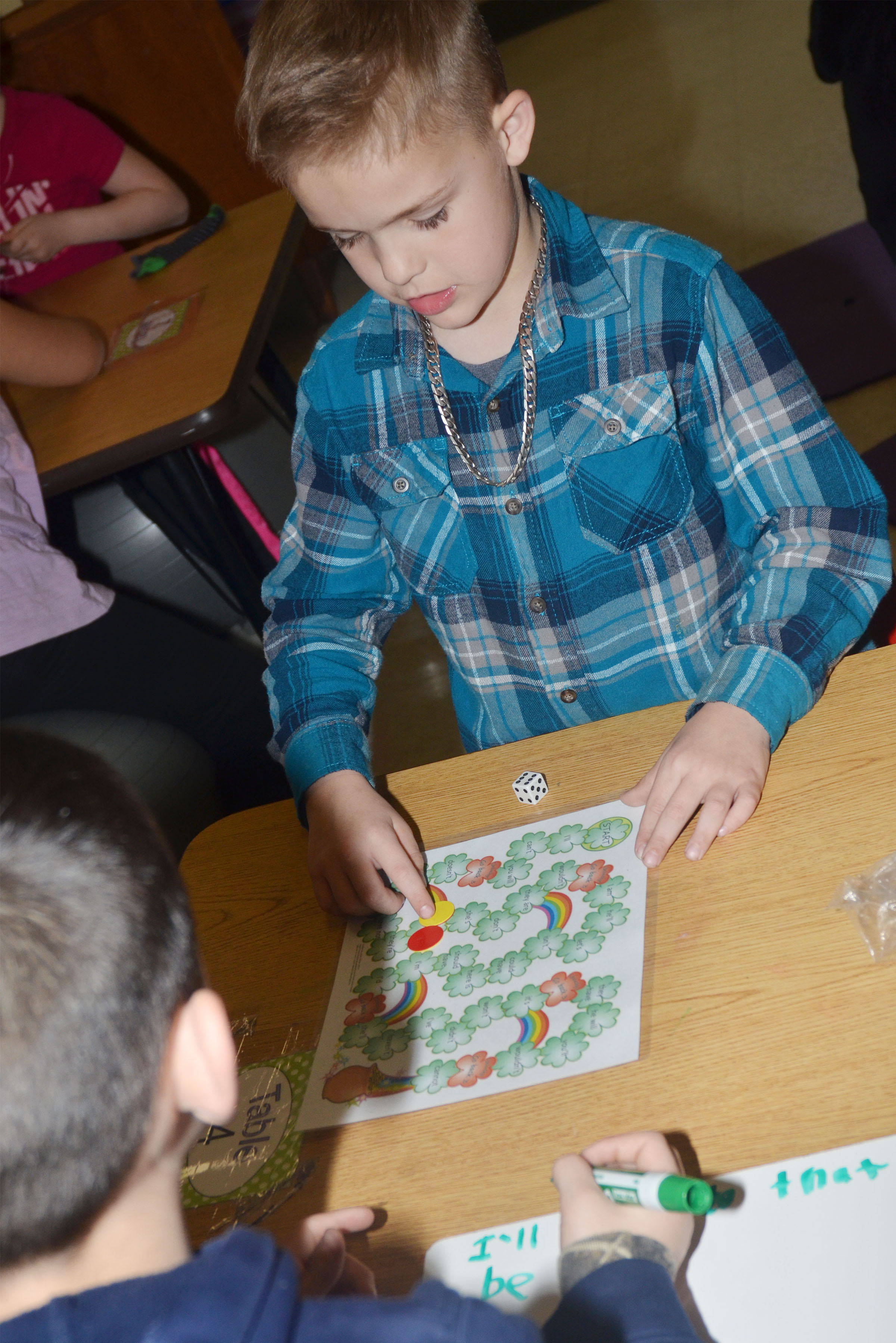 CES second-grader Kadin Coppage plays the pot of gold game.