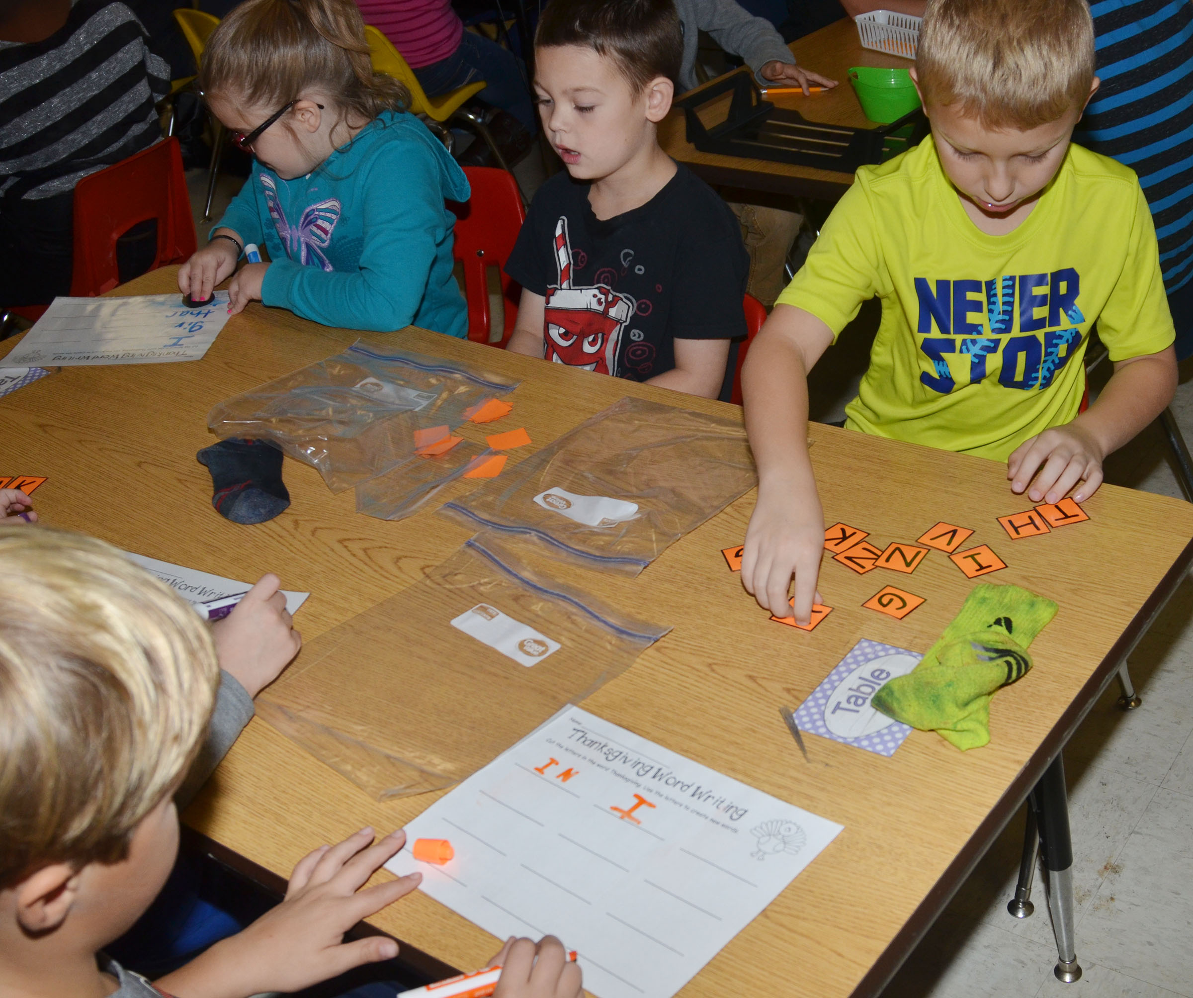 CES second-grader Mason Davis works with his partner to form words out of the letters in Thanksgiving.