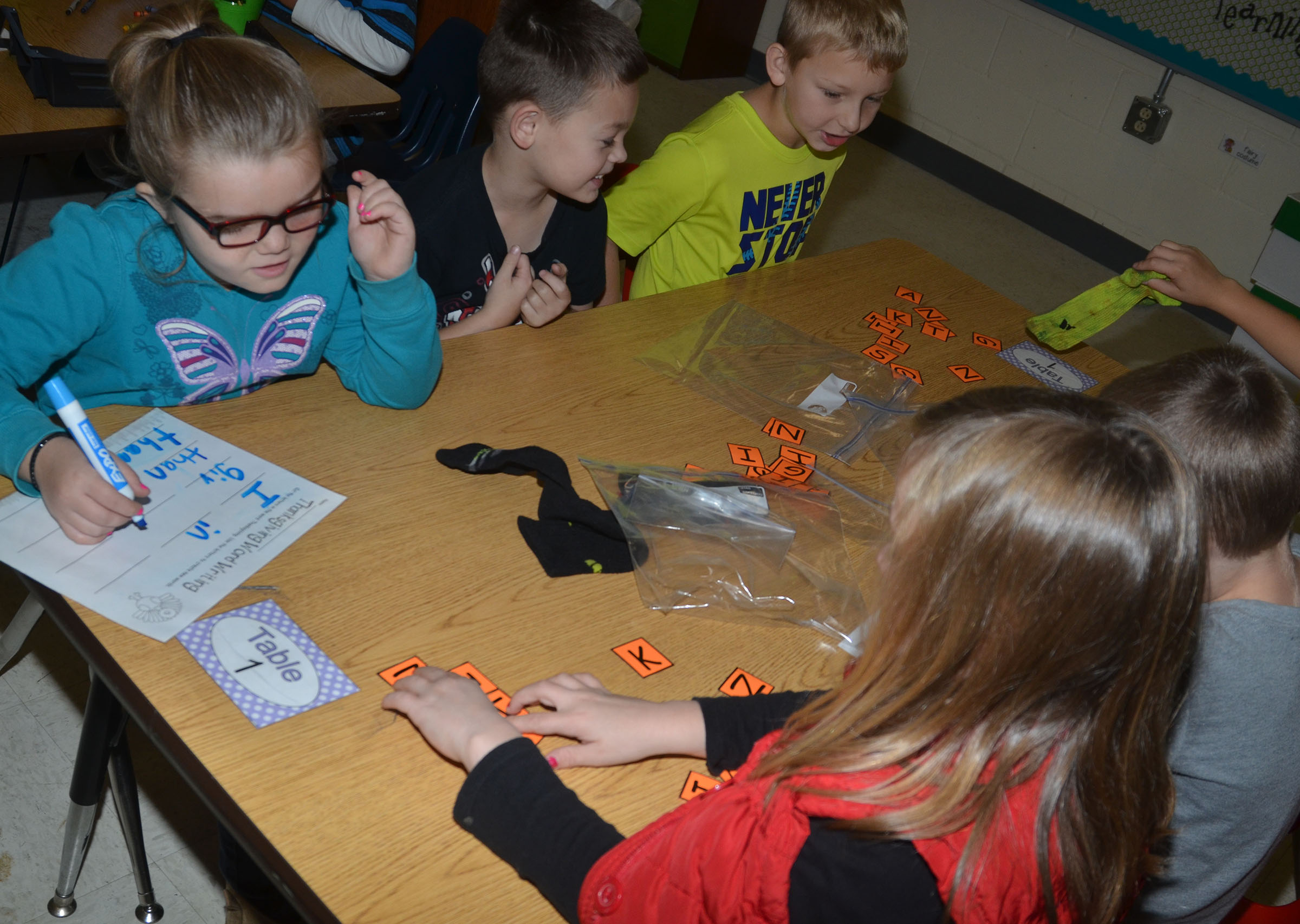 CES second-grader Jaylin Christie works with her partner to form words out of the letters in Thanksgiving.