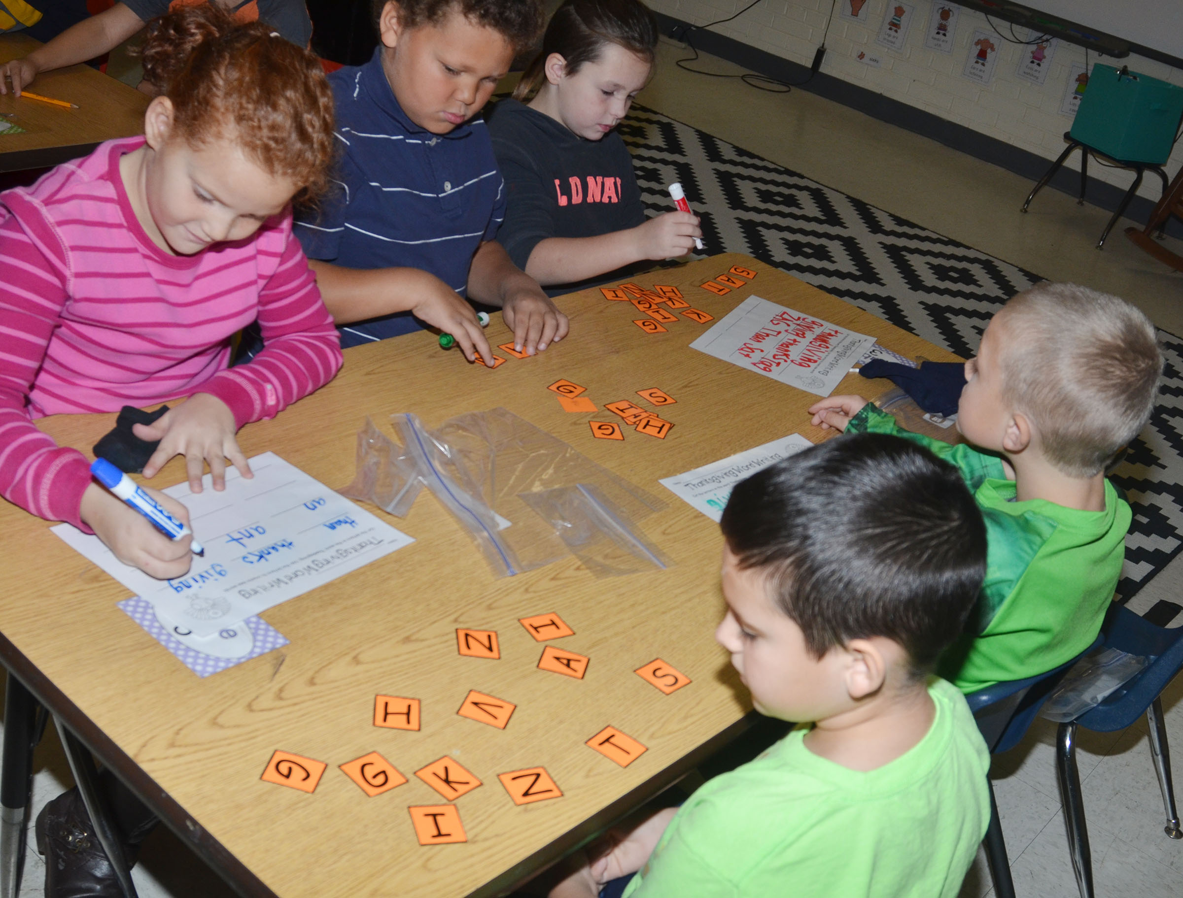 CES second-graders Analeigh Foster, at left, and her partner, Damien Clark, work together to form words out of the letters in Thanksgiving.