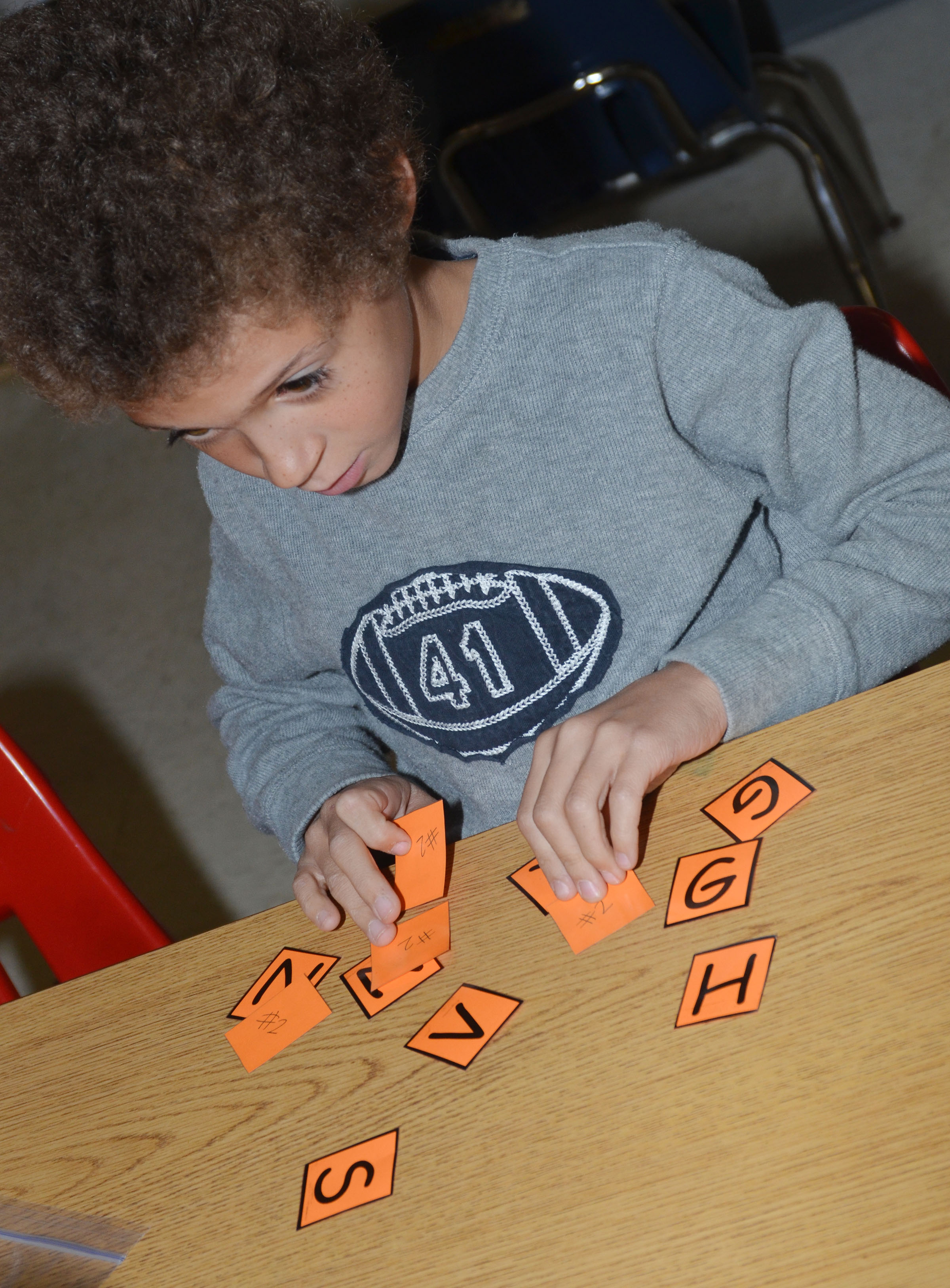 CES second-grader Trever Lasley forms words out of the letters in Thanksgiving.