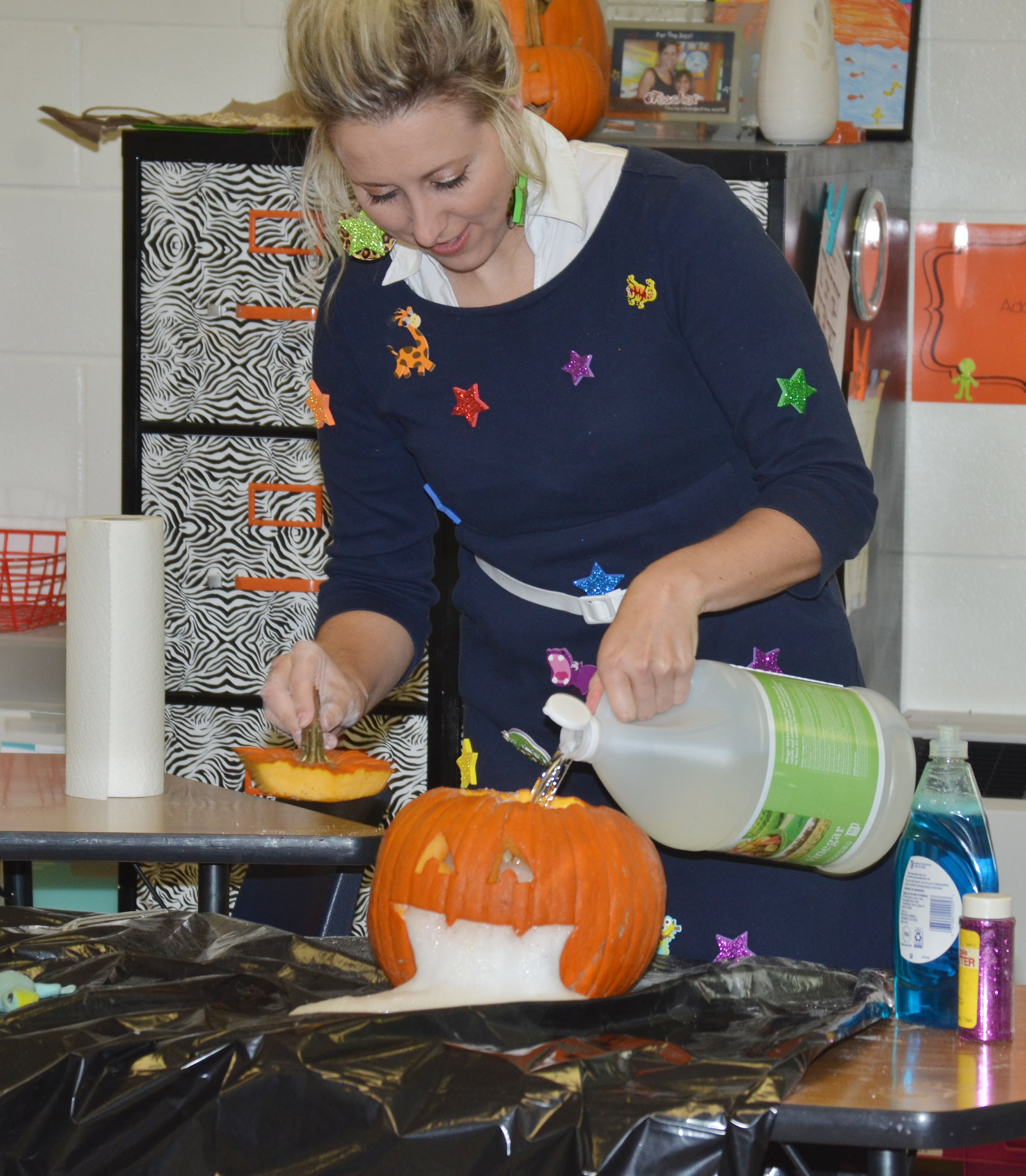 CES third-grade teacher Hannah Jones performs a spooky science experiment for students.