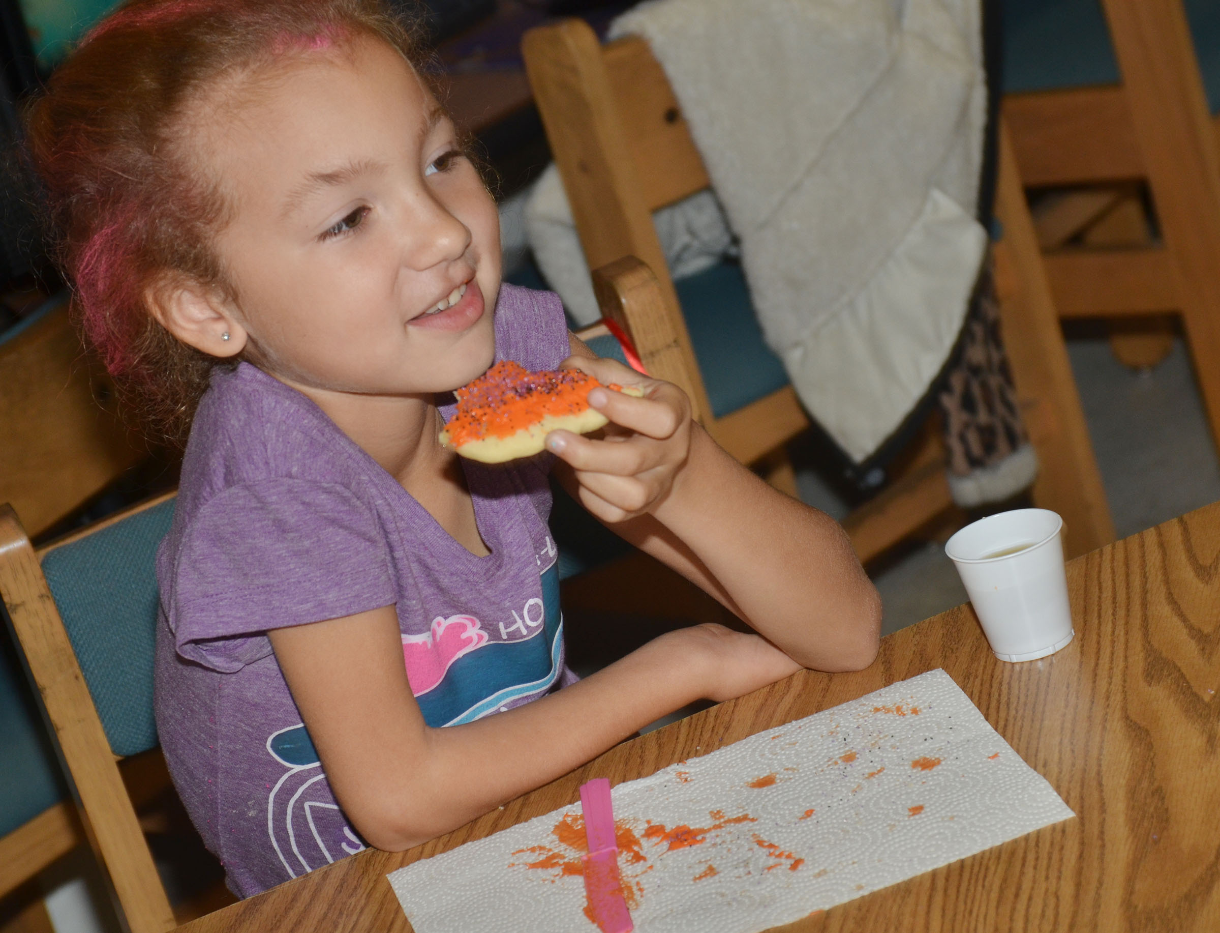 CES third-grader Raelyn Dunn eats the cookie she decorated.