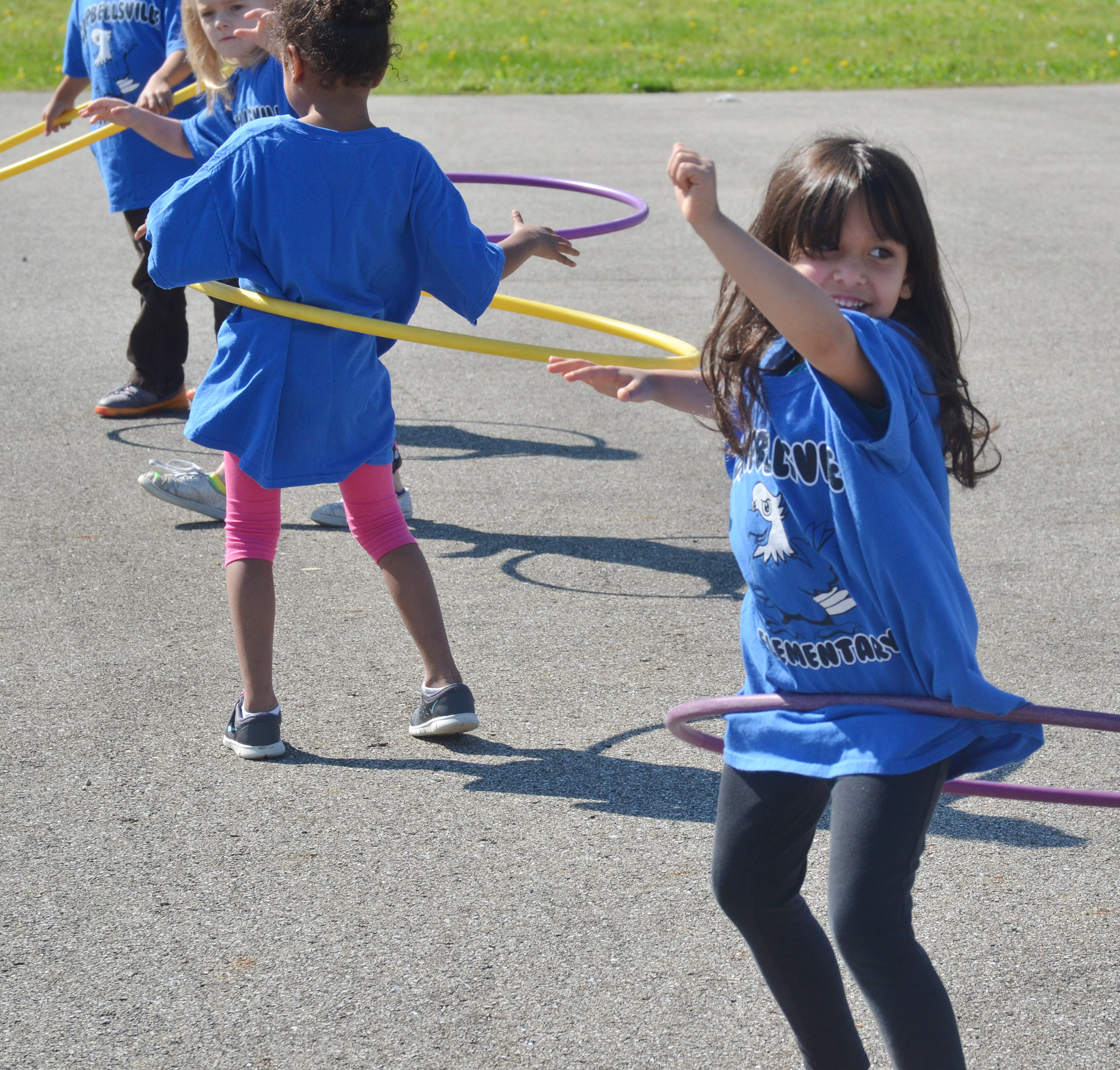CES kindergartener Carol Moura competes in the hula hoop competition.