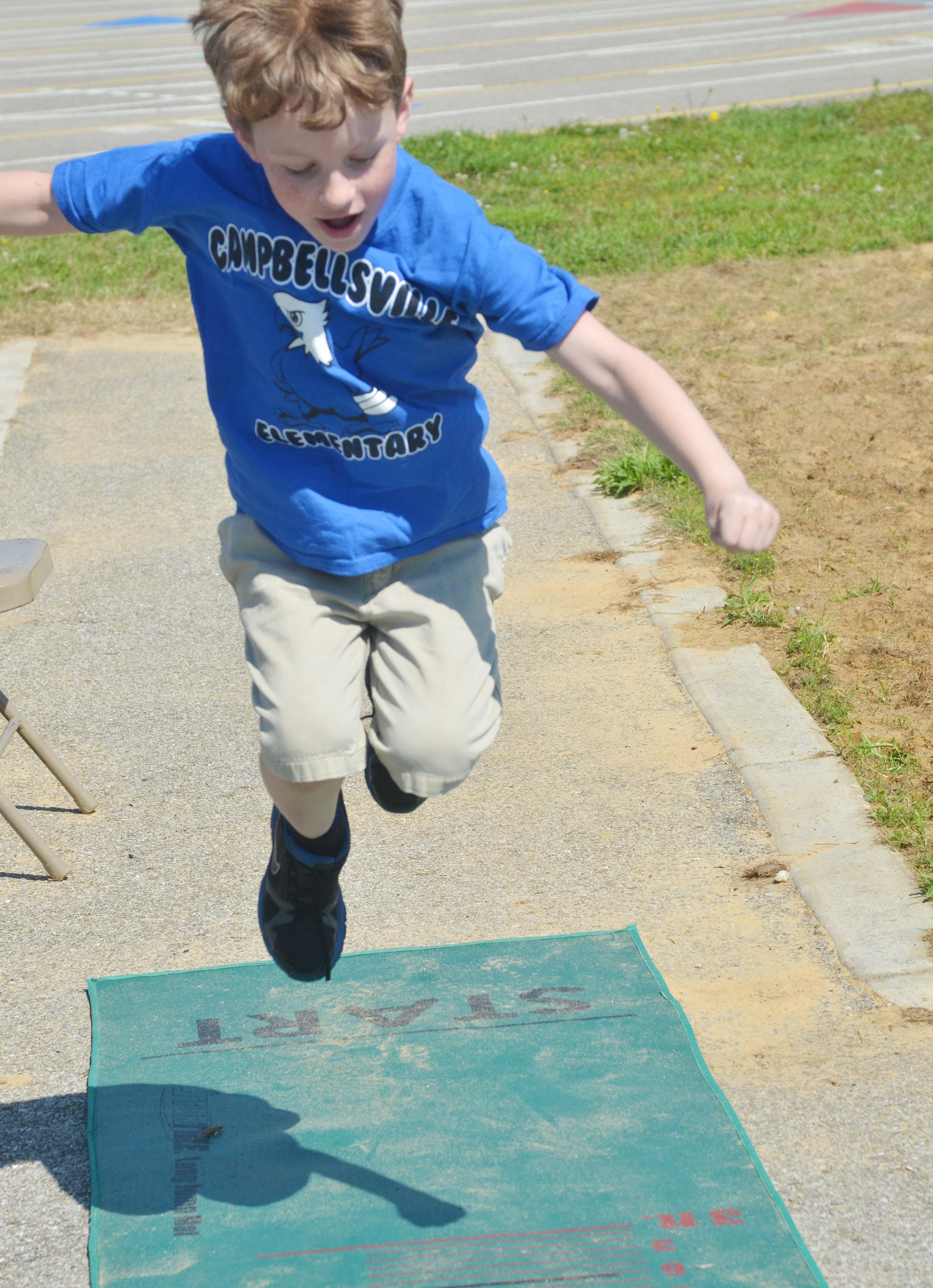 CES first-grader Jayden Cox jumps.