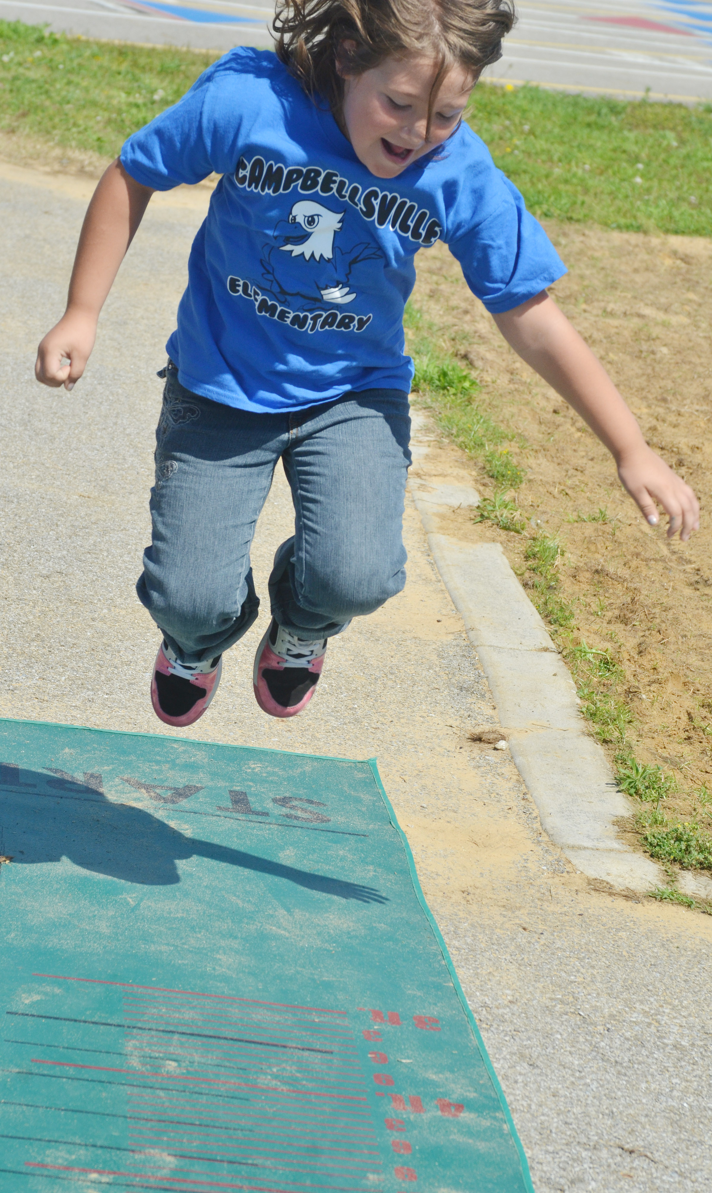 CES first-grader Destiny Rhinehart jumps.