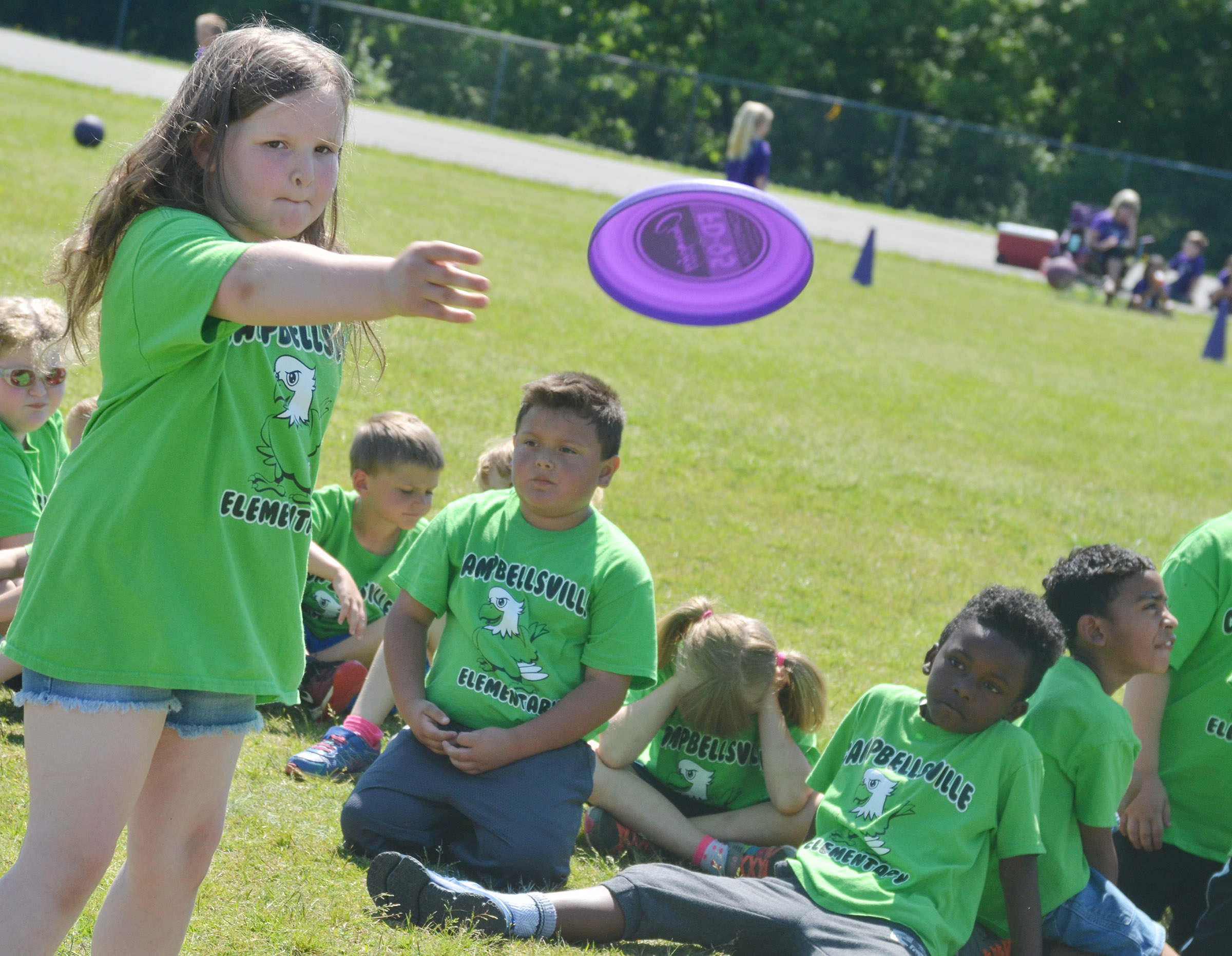 CES first-grader Kierra Maupin throws a Frisbee.