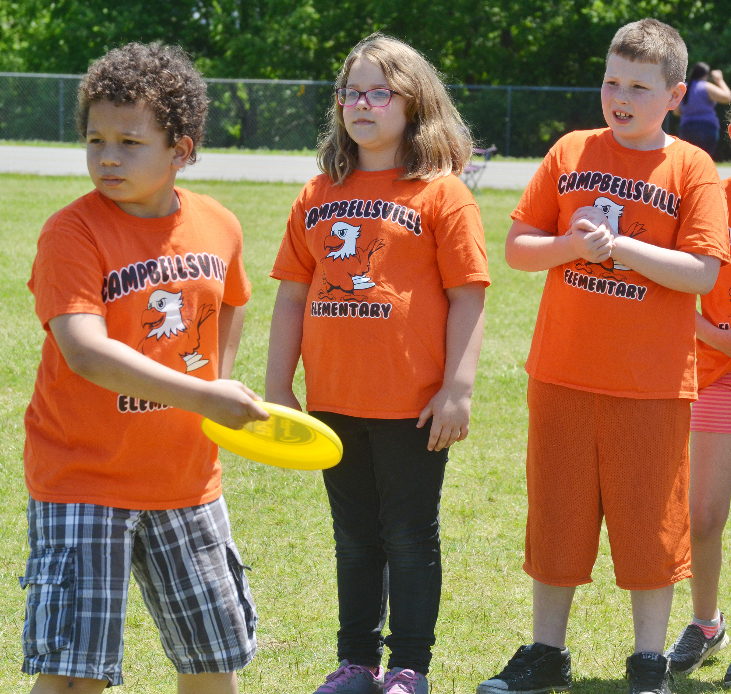 CES third-grader Toby Adams throws a Frisbee.