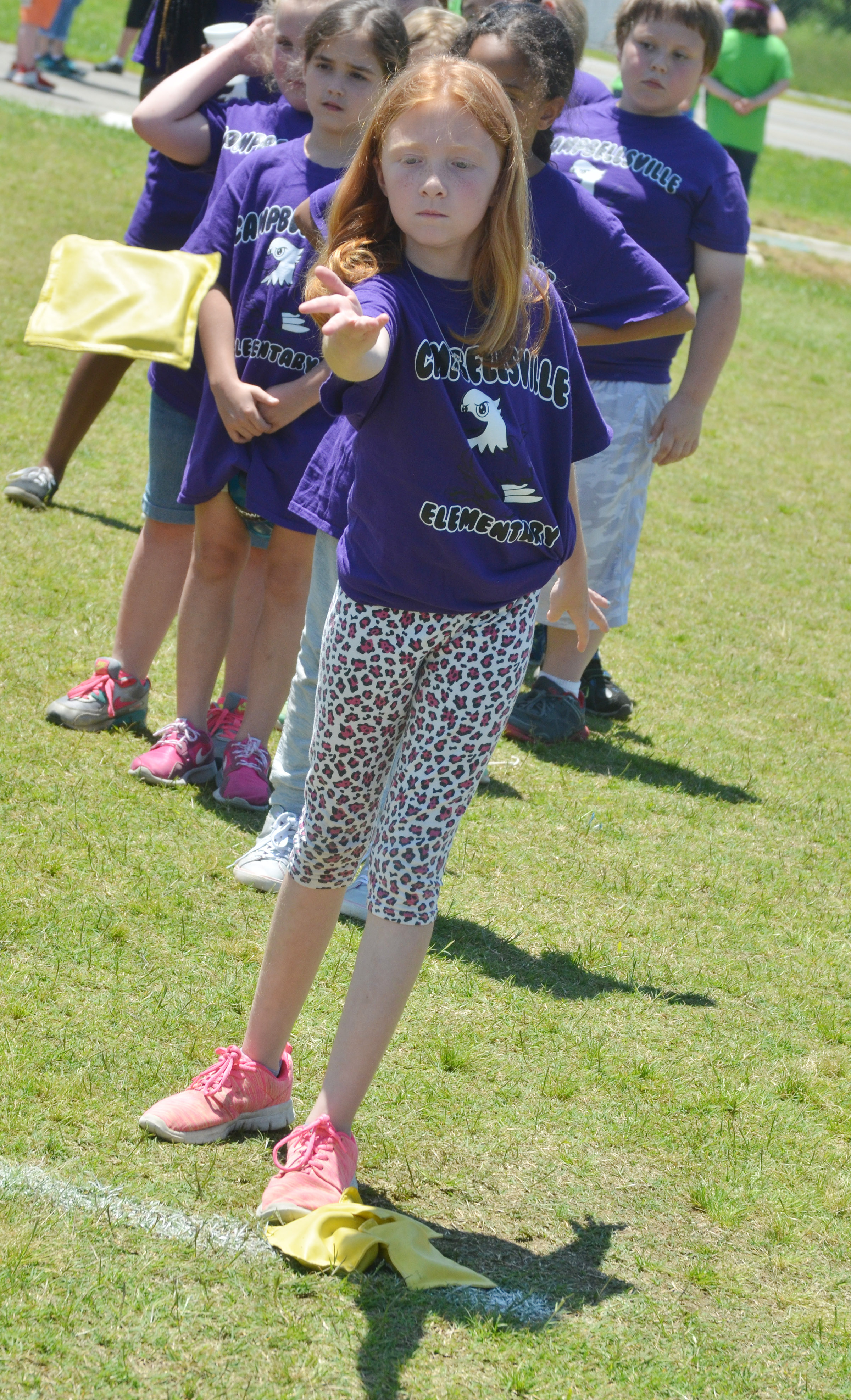 CES third-grader Savannah Wethington throws a bean bag.