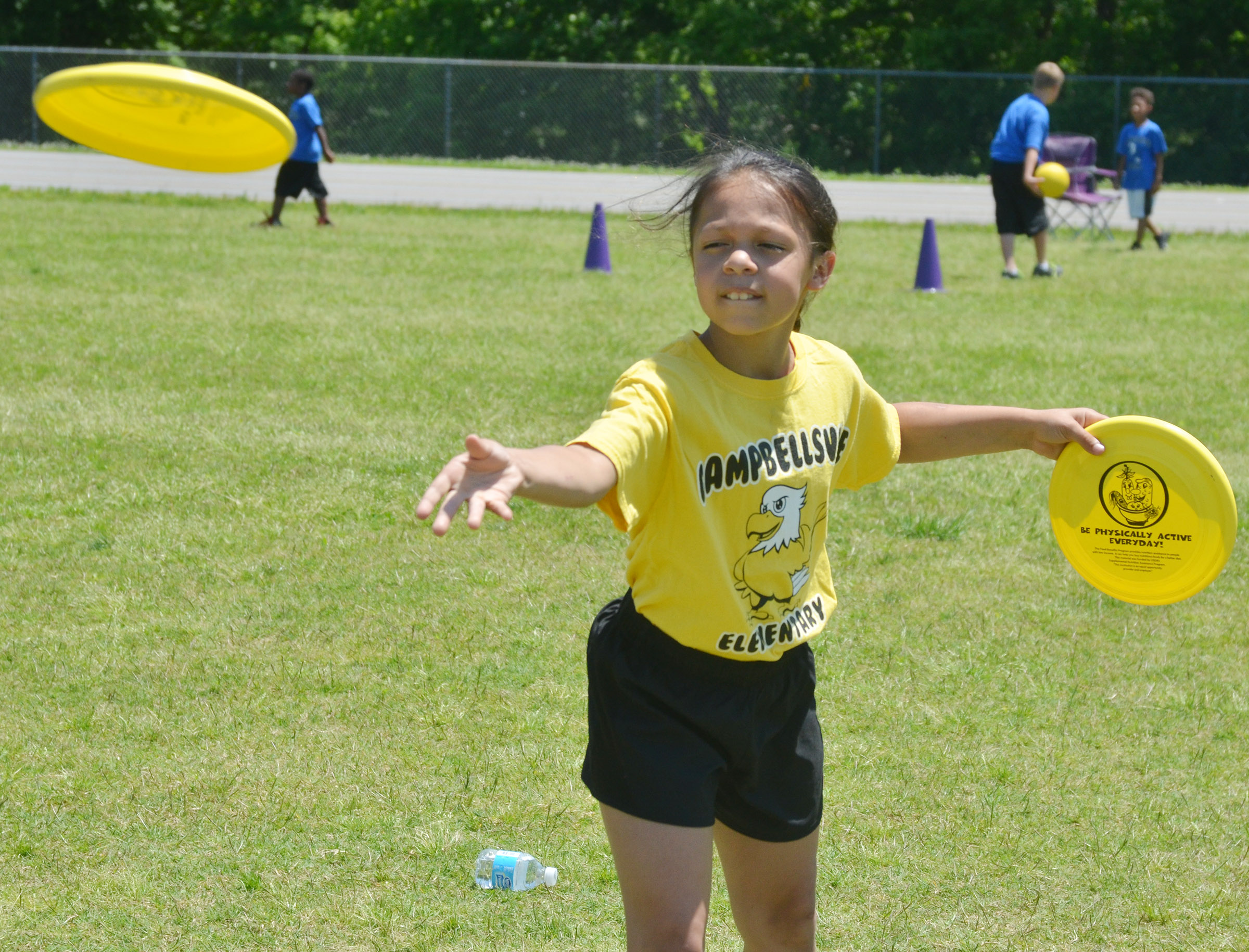 CES third-grader Breona Bridgewater throws a Frisbee.