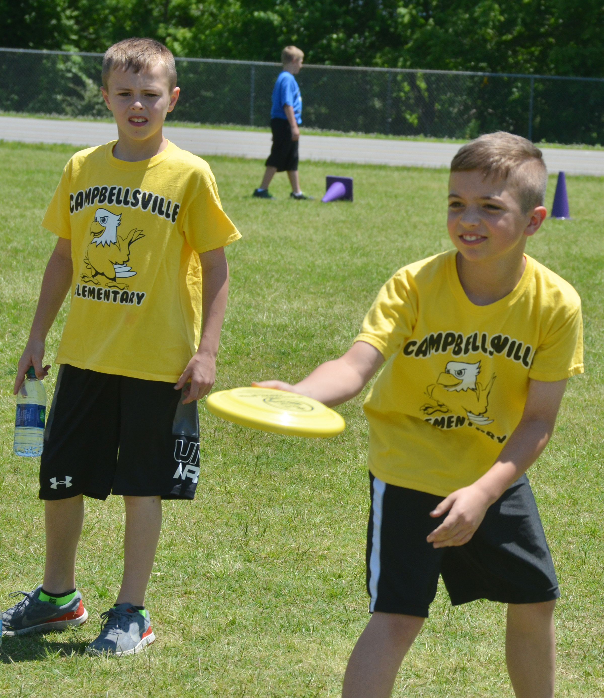 CES third-grader Carson Mills throws a Frisbee.