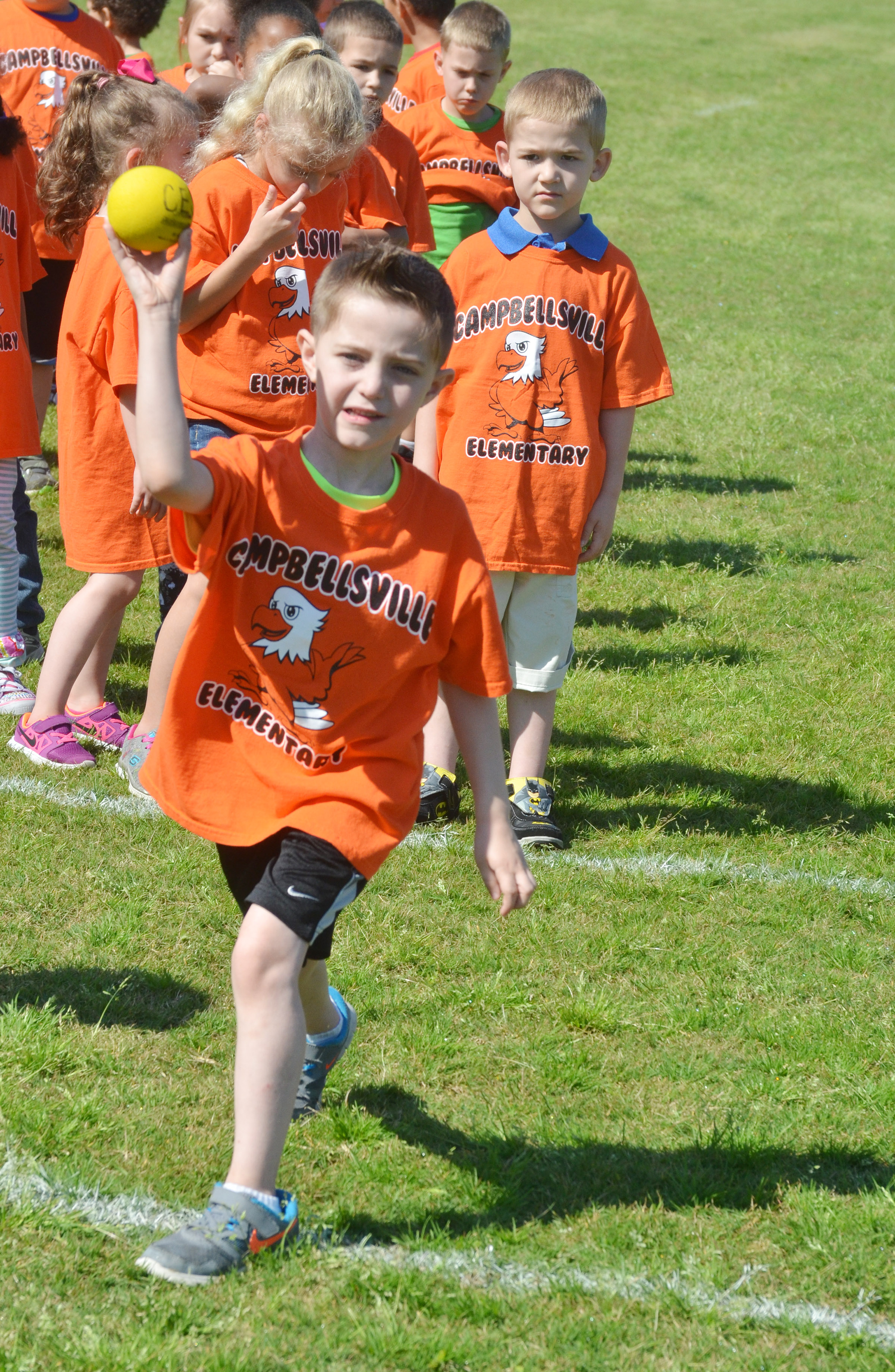 CES kindergartener Caleb Goodson competes in the ball throw.