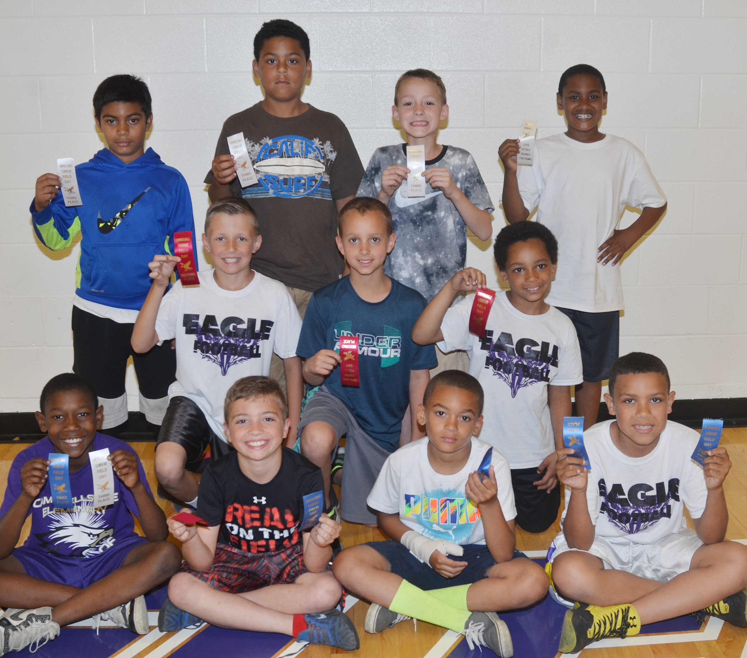 CES third-grade boys who were classroom winners in the 50-yard dash are, from left, front, Jaron Johnson, Carson Mills, Jaden Barbee and Christian Hart, first place winners. Second row, Cameron Taylor, Bradley Paris and Jalen Embry, second place winners. Back, LaDainien Smith, Bryson Groves, Caysen Tungate and Shaiden Calhoun, third place winners. Absent from the photo is Demetrious Dickens, who was a second place winner. Overall, Christian Hart was first, Carson Mills was second and Jaron Johnson was third.