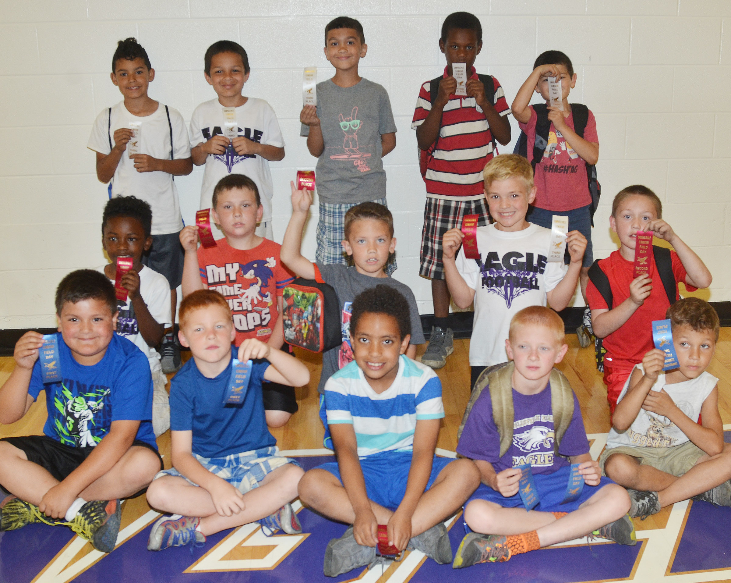 CES first-grade boys who were classroom winners in the 50-yard dash are, from left, front, Eric Mixtega, Carter Wethington, Romeo Goins, Jacob Wethington and Shylan Dunn, who were first place winners. Second row, Drelynn Hollins, Fabrizio Segura, Owen Skaggs, Dax Gray and Jacob Golden, second place winners. Back, Rizzo McKenzie, Makyian Bridgewater, Xadrian Fugate, Lazarick Miller and Henry Martinez, third place winners. Overall, Jacob Wethington was first, Romeo Goins was second and Dax Gray was third.