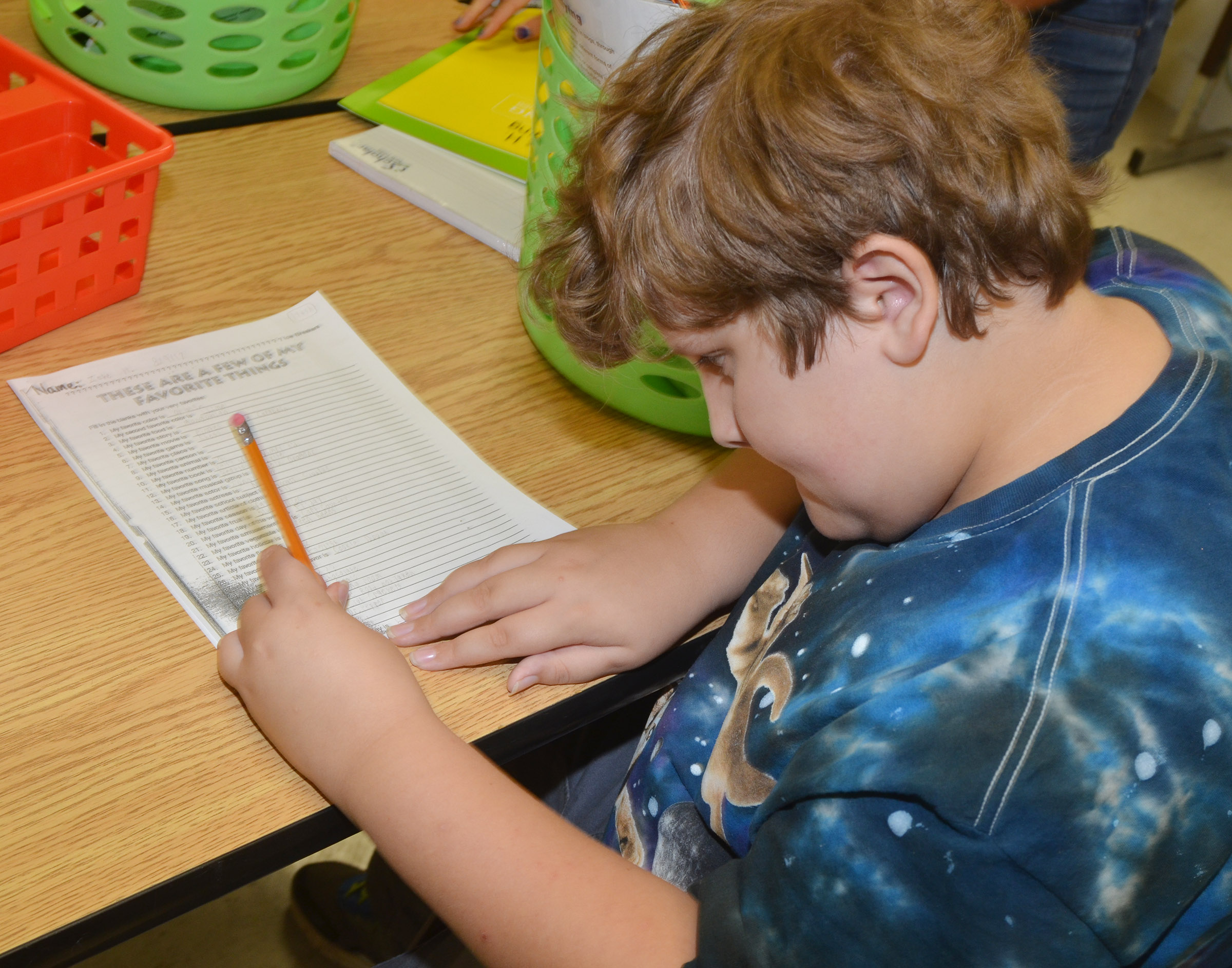 CES fifth-grader Zeke Harris completes a worksheet to help his teacher learn about him.