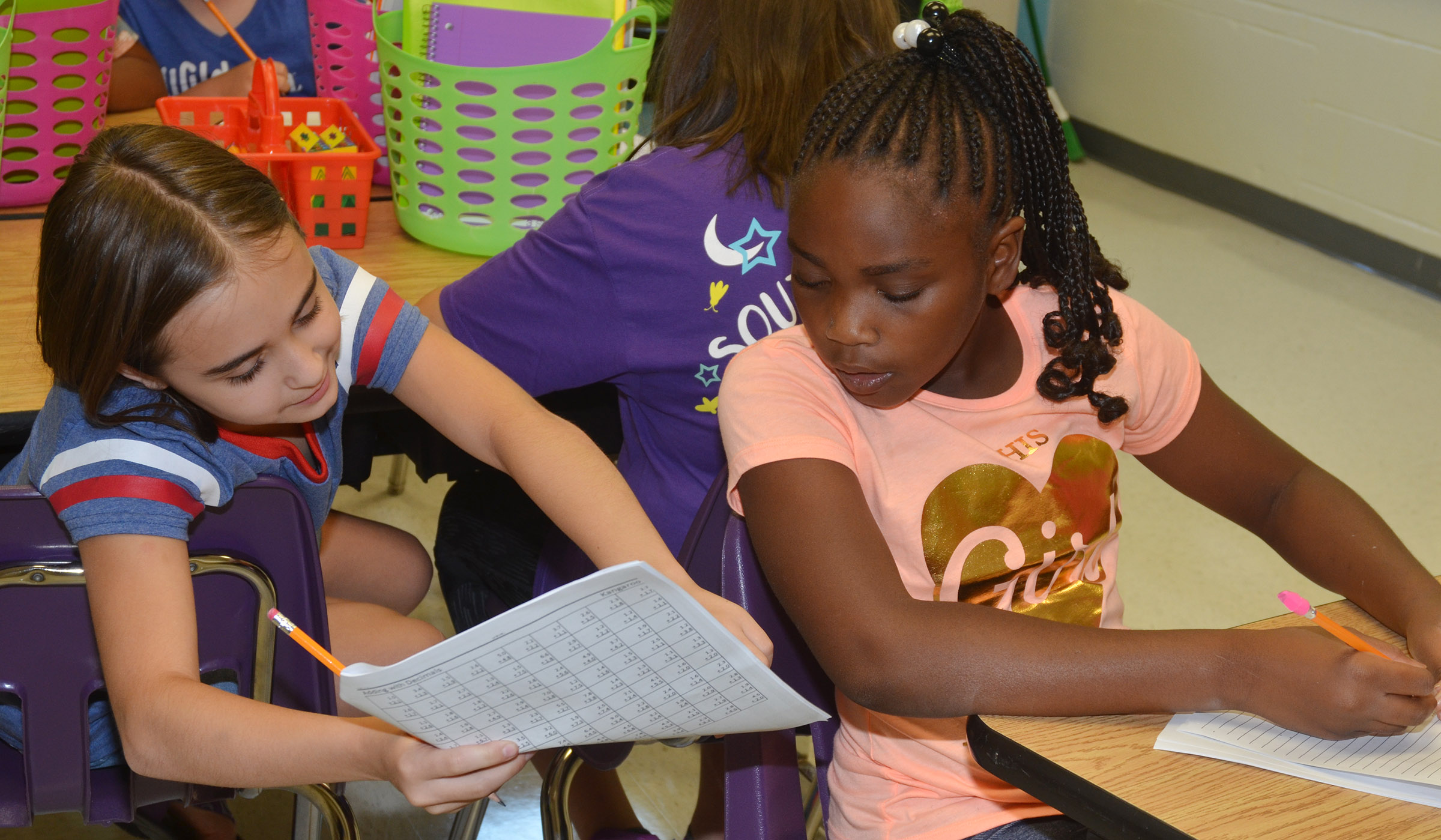 CES fifth-graders Anna Floyd, at left, and Ta'Zaria Owens talk about an assignment.
