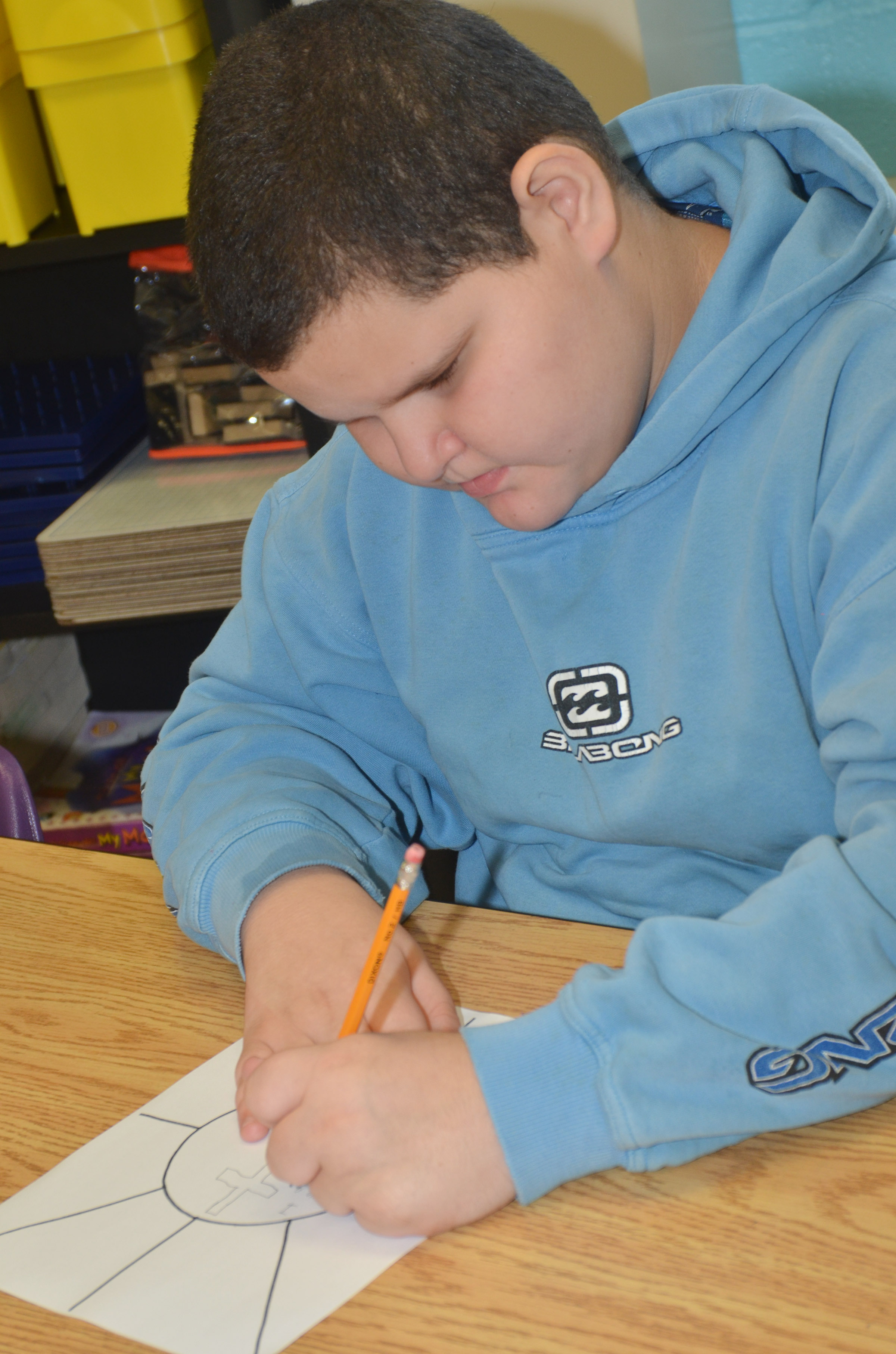 CES fifth-grader Steven Miller completes an assignment to help his teacher learn about him.