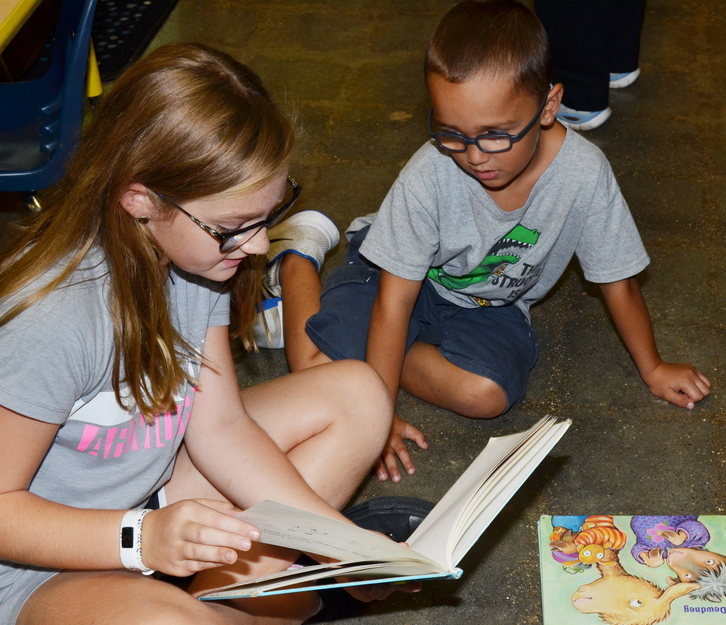 CES fifth-grader Lilyan Murphy reads to kindergartener Chanler Mann.