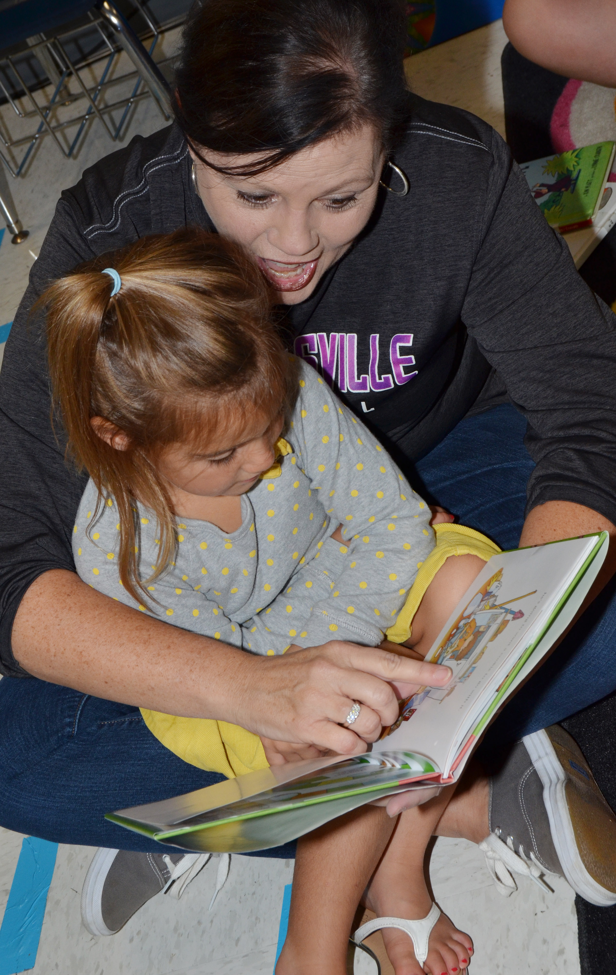 CES fifth-grade teacher Lisa Kearney reads to kindergartener Blakely Gray.
