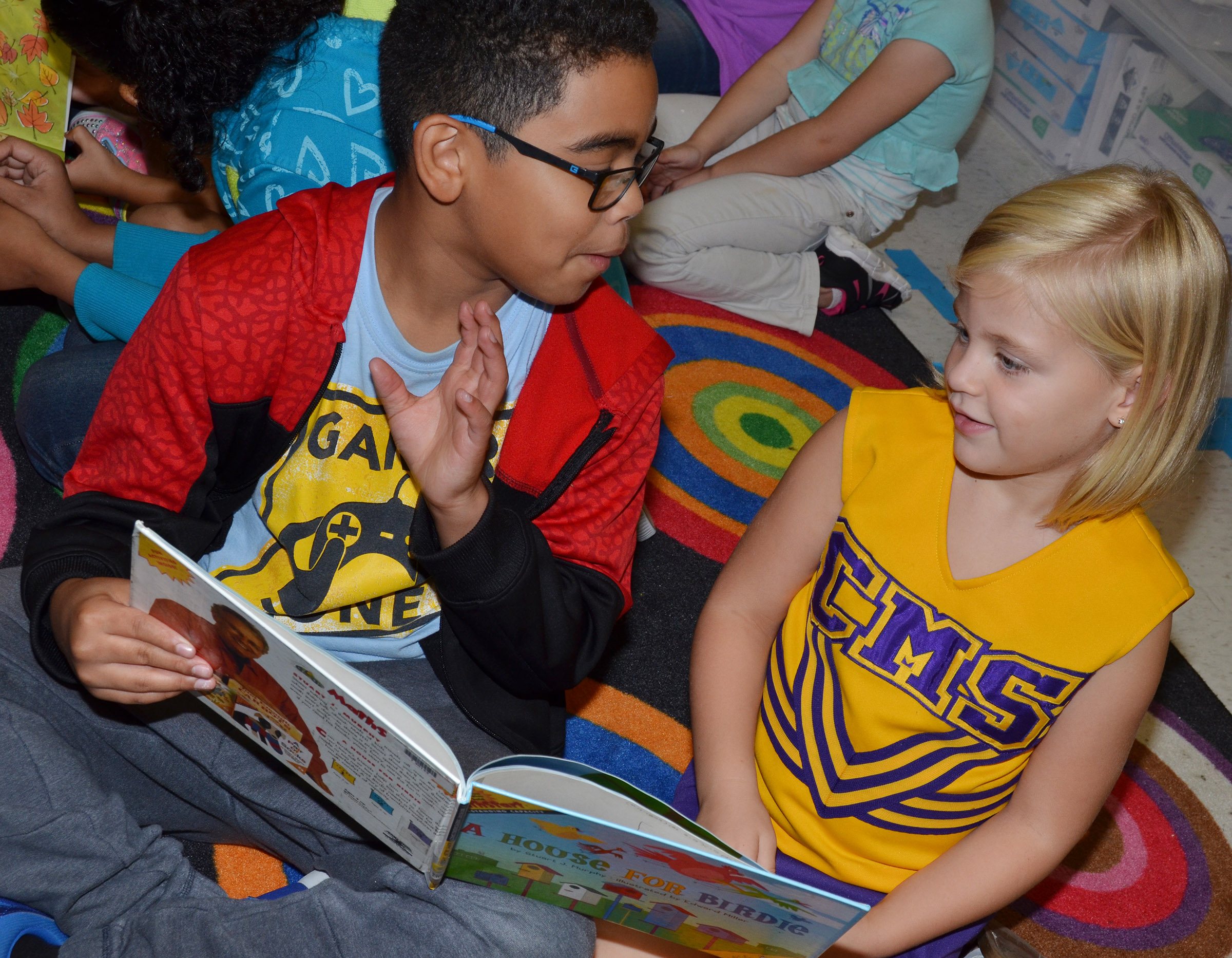 CES fifth-grader Gabriel Noyola reads to kindergartener Remi Petett.