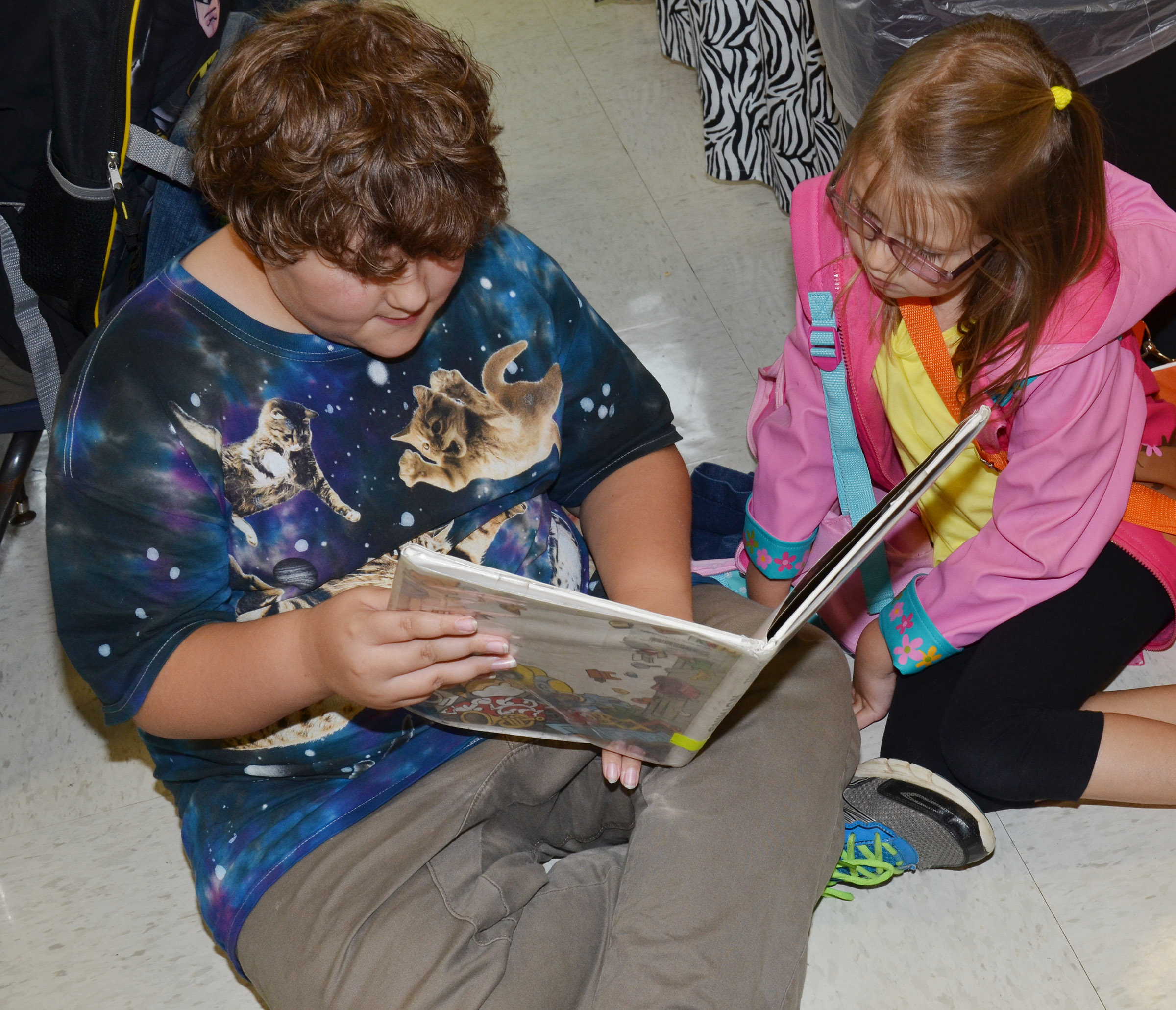CES fifth-grader Zeke Harris reads to kindergartener Emmaline Vespie.
