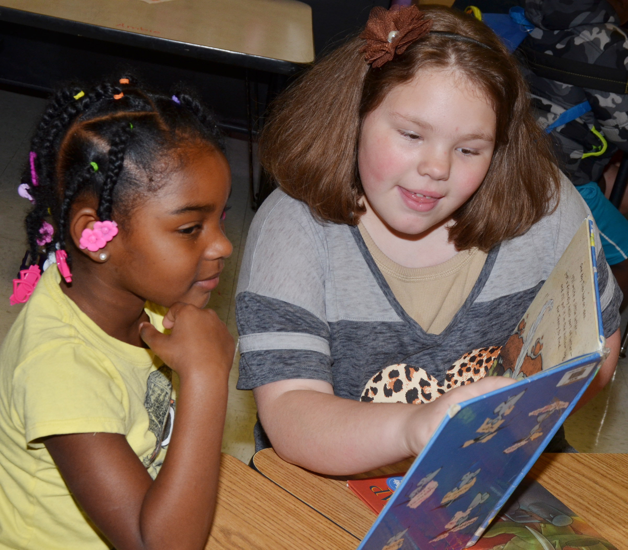 CES fifth-grader Averi Perkins reads to kindergartener Mariah Harris.