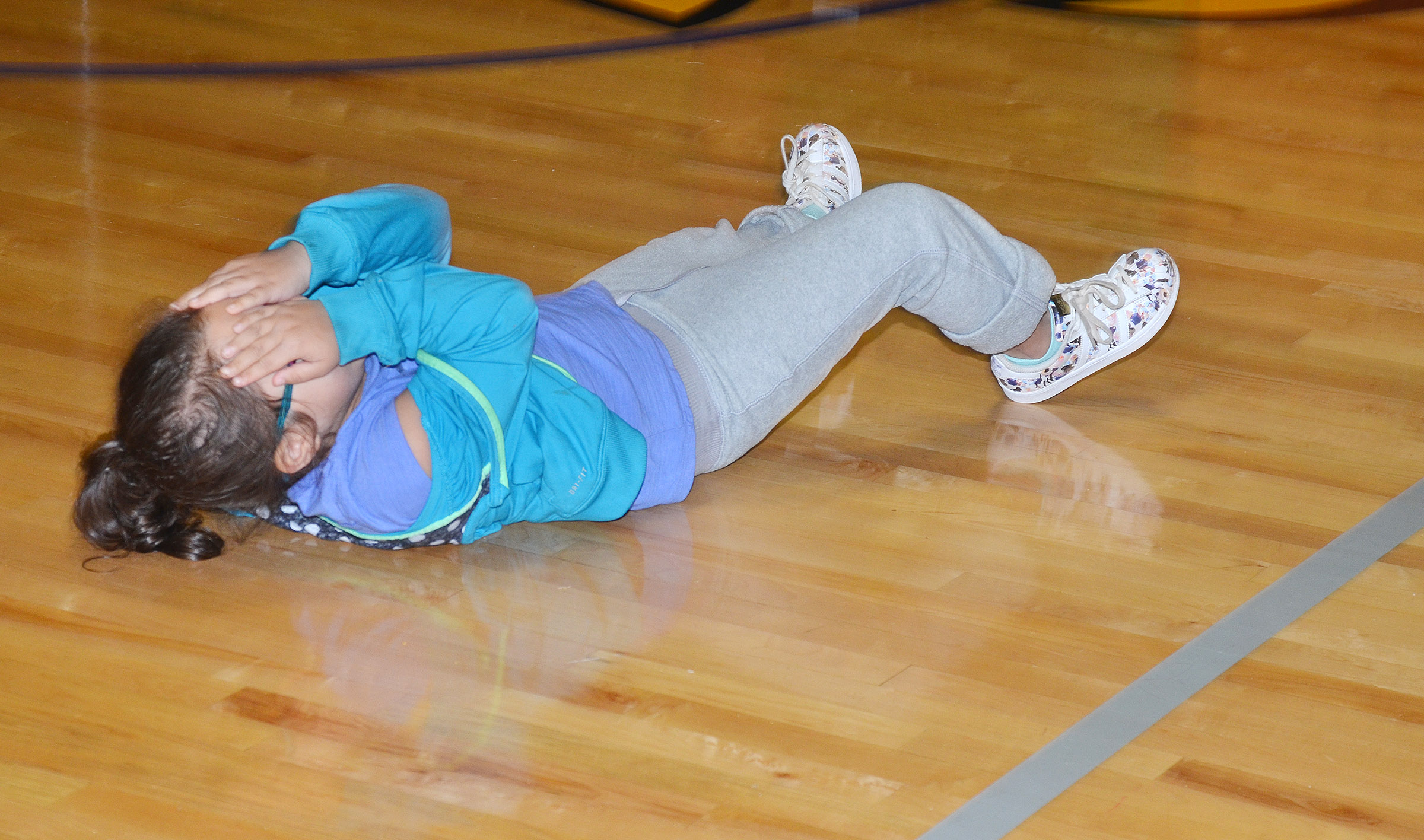 CES kindergartener Addisyn Taylor shows how to stop, drop and roll.