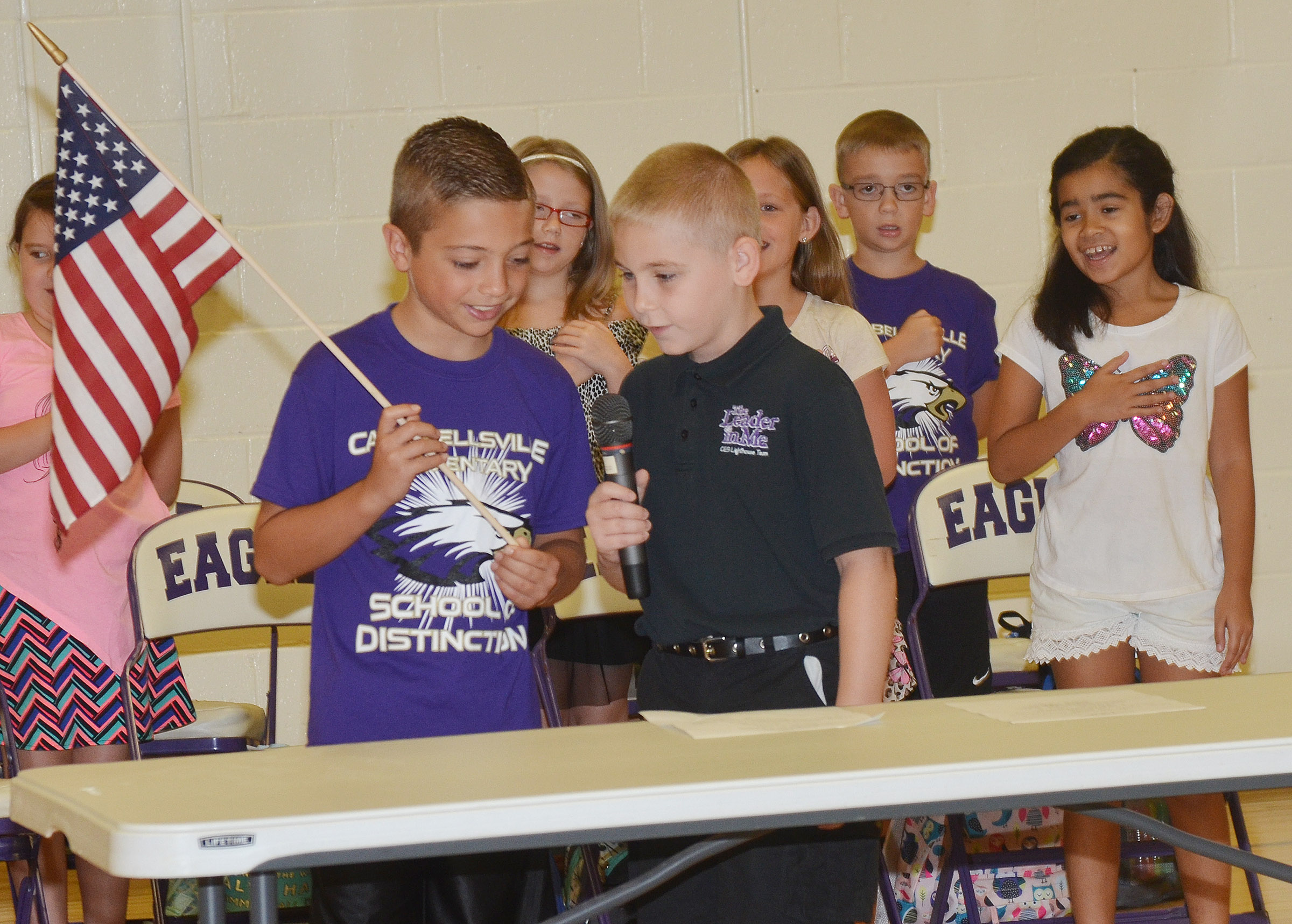 CES fourth-grader Carson Mills, at left, and third-grader Joseph Greer lead their school in saying the Pledge of Allegiance.