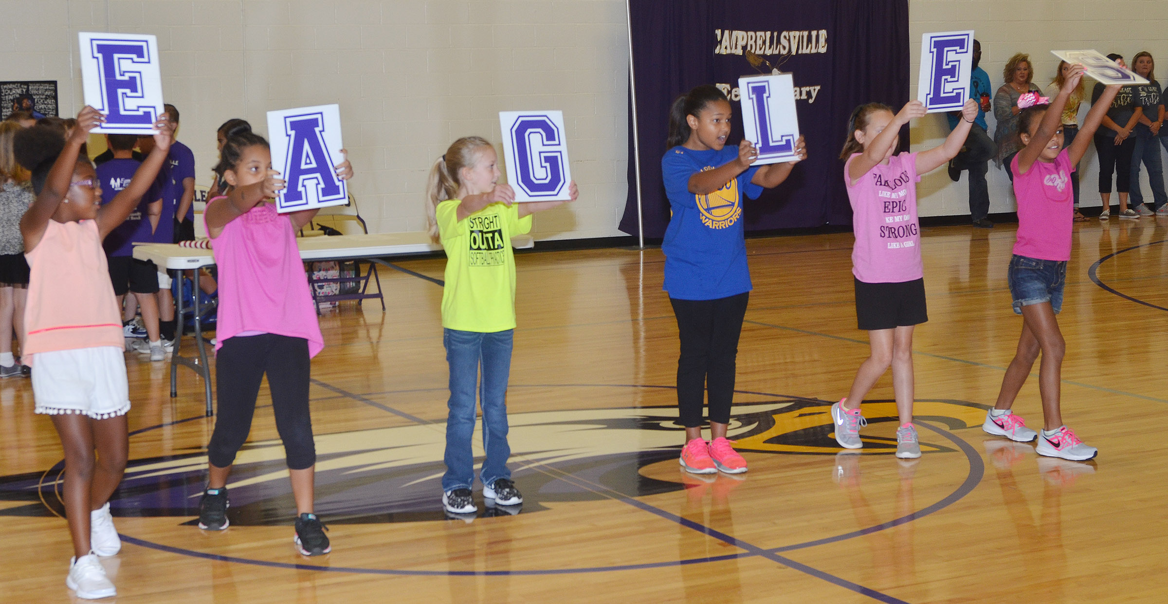 CES students lead their classmates in a cheer for the Eagles.