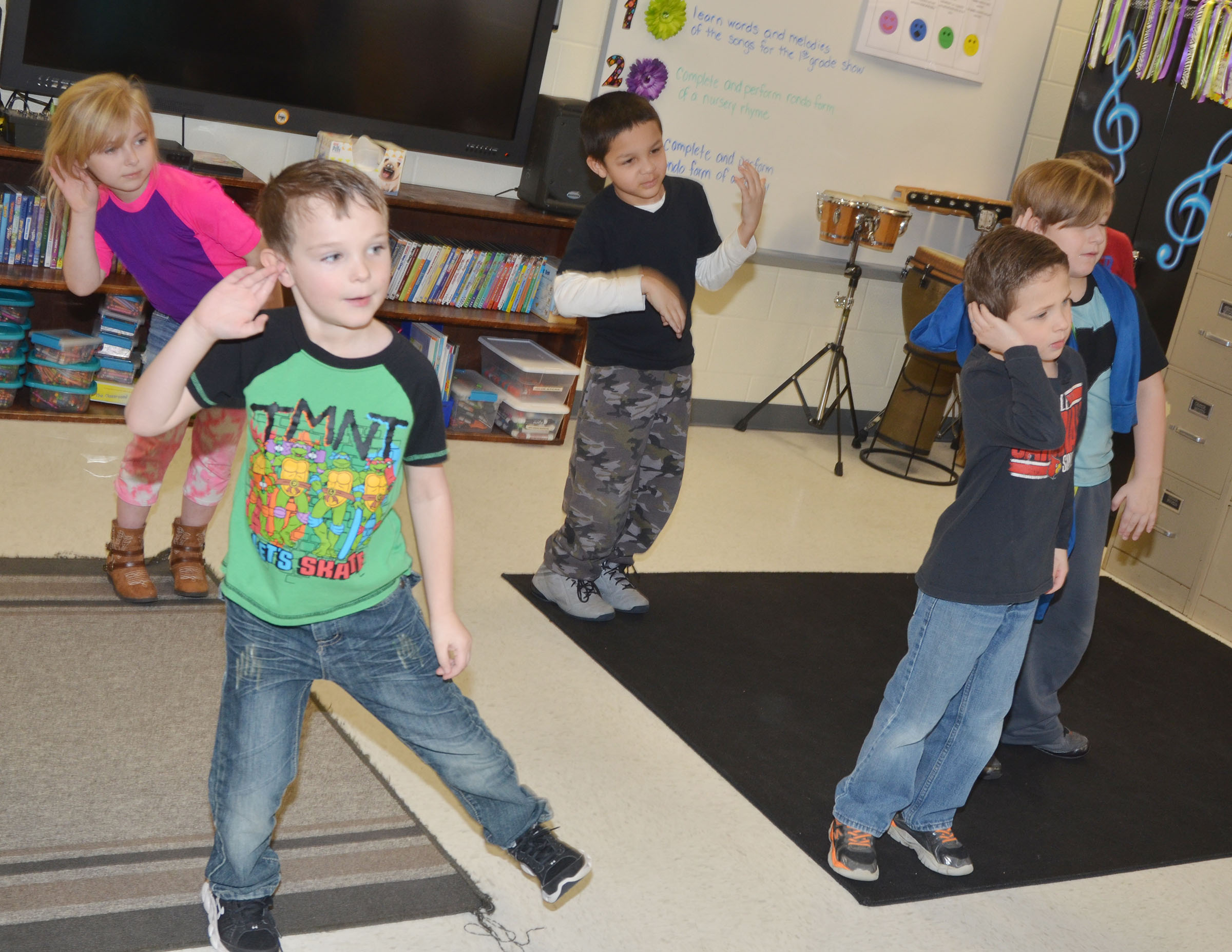 CES first-grader Karson Burchett and his classmates practice their dance moves.