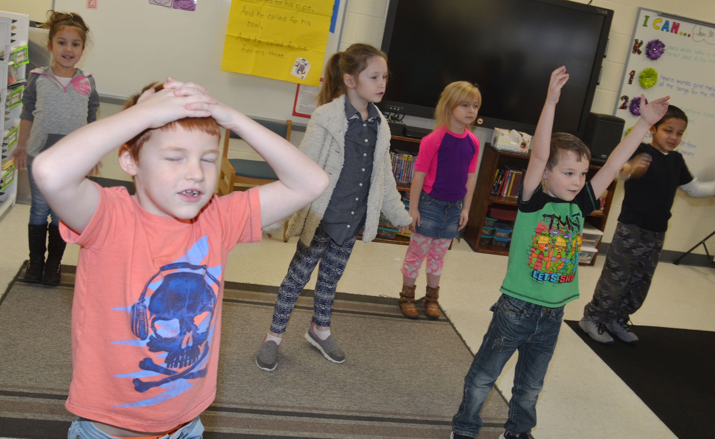 CES first-grader Carter Wethington and his classmates practice their dance moves.