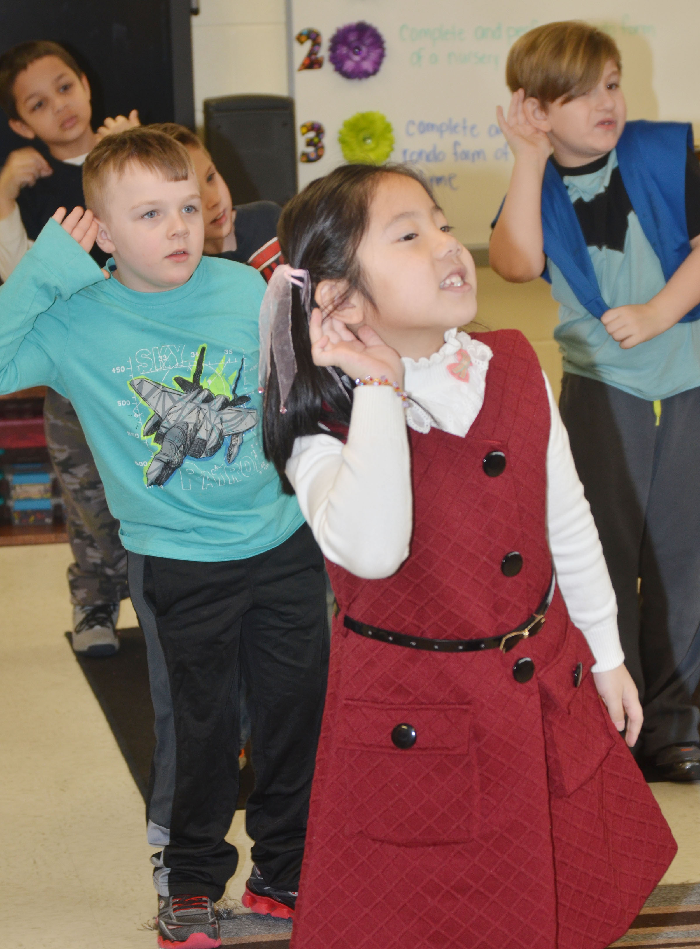 CES first-grader Tina Jiang and her classmates practice their dance moves.