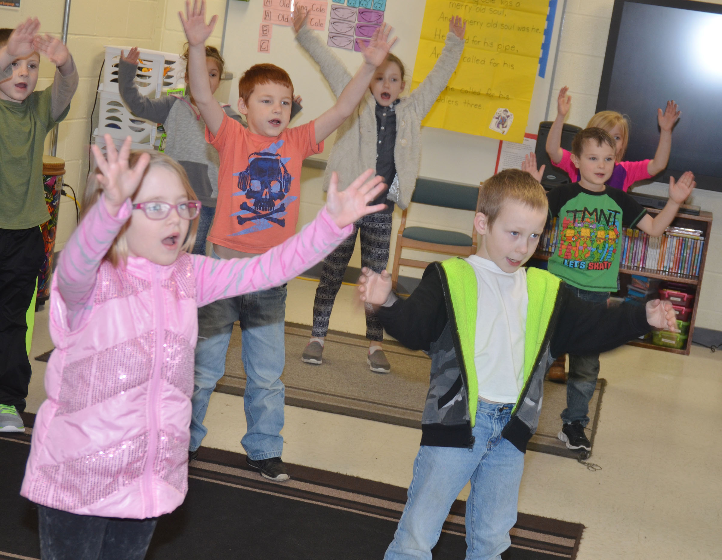 CES first-graders practice their dance moves.