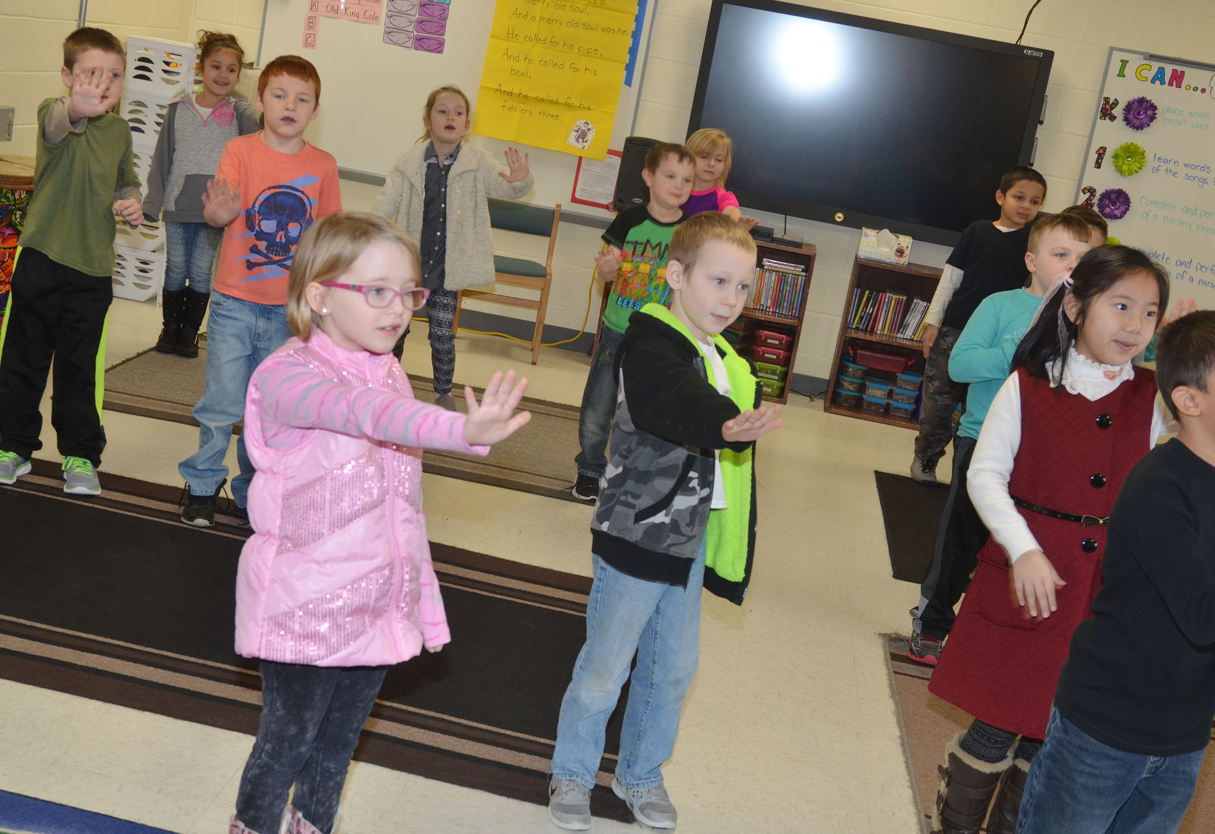 CES first-graders dance together.