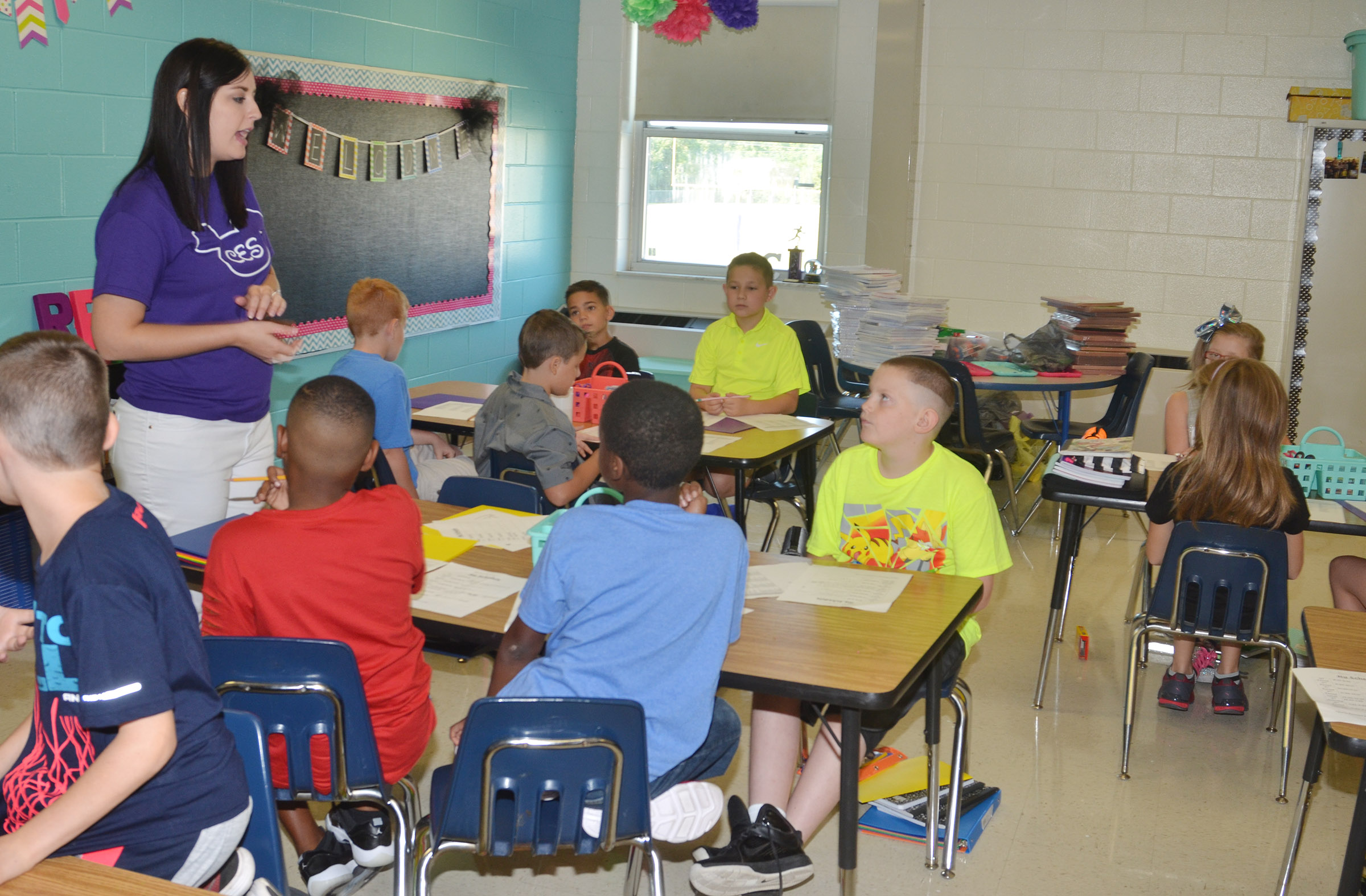 CES fourth-grade teacher Samantha Coomer talks to her students about their daily schedule.