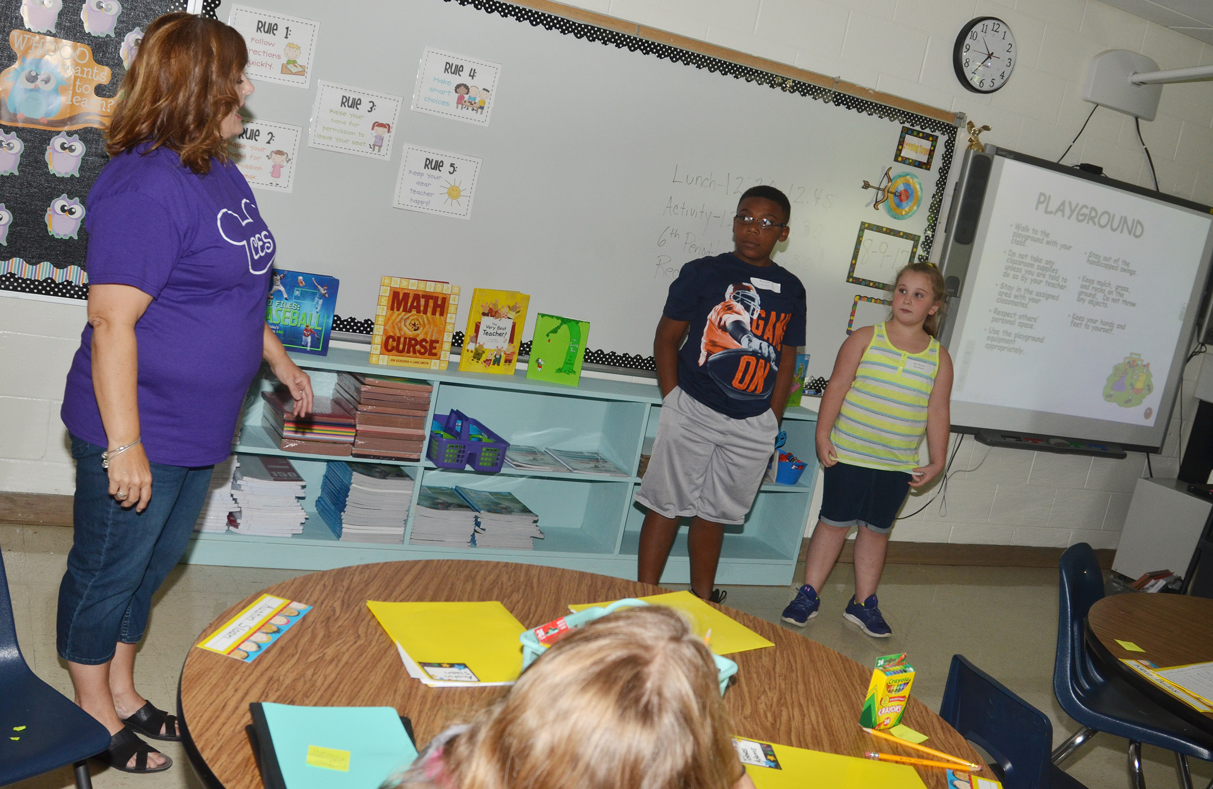 CES fourth-graders Austin Sloan and Kiera Bailey help teacher Garnetta Murrell explain the playground rules to their classmates.