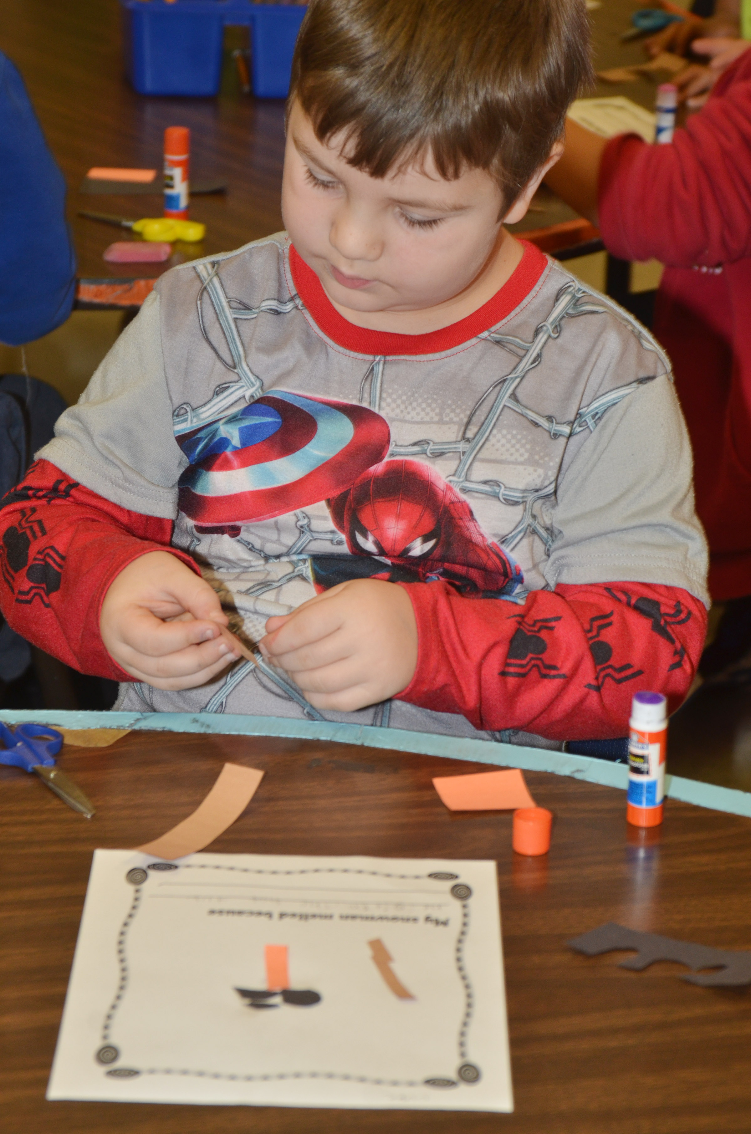 CES first-grader Luke Mardis makes his melting snowman and then writes why he melted.