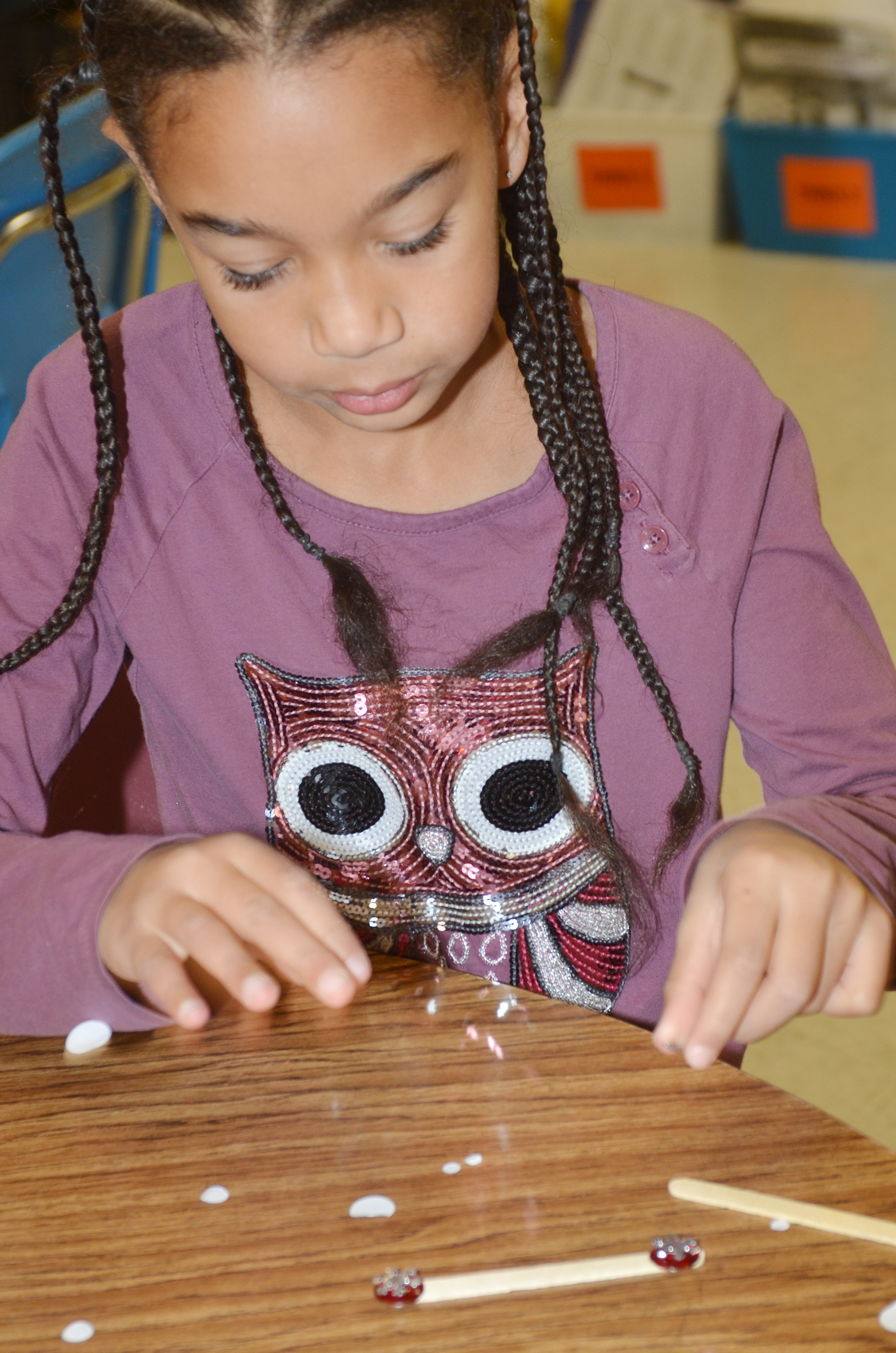 CES third-grader De'Asia Fisher makes a snowflake ornament.