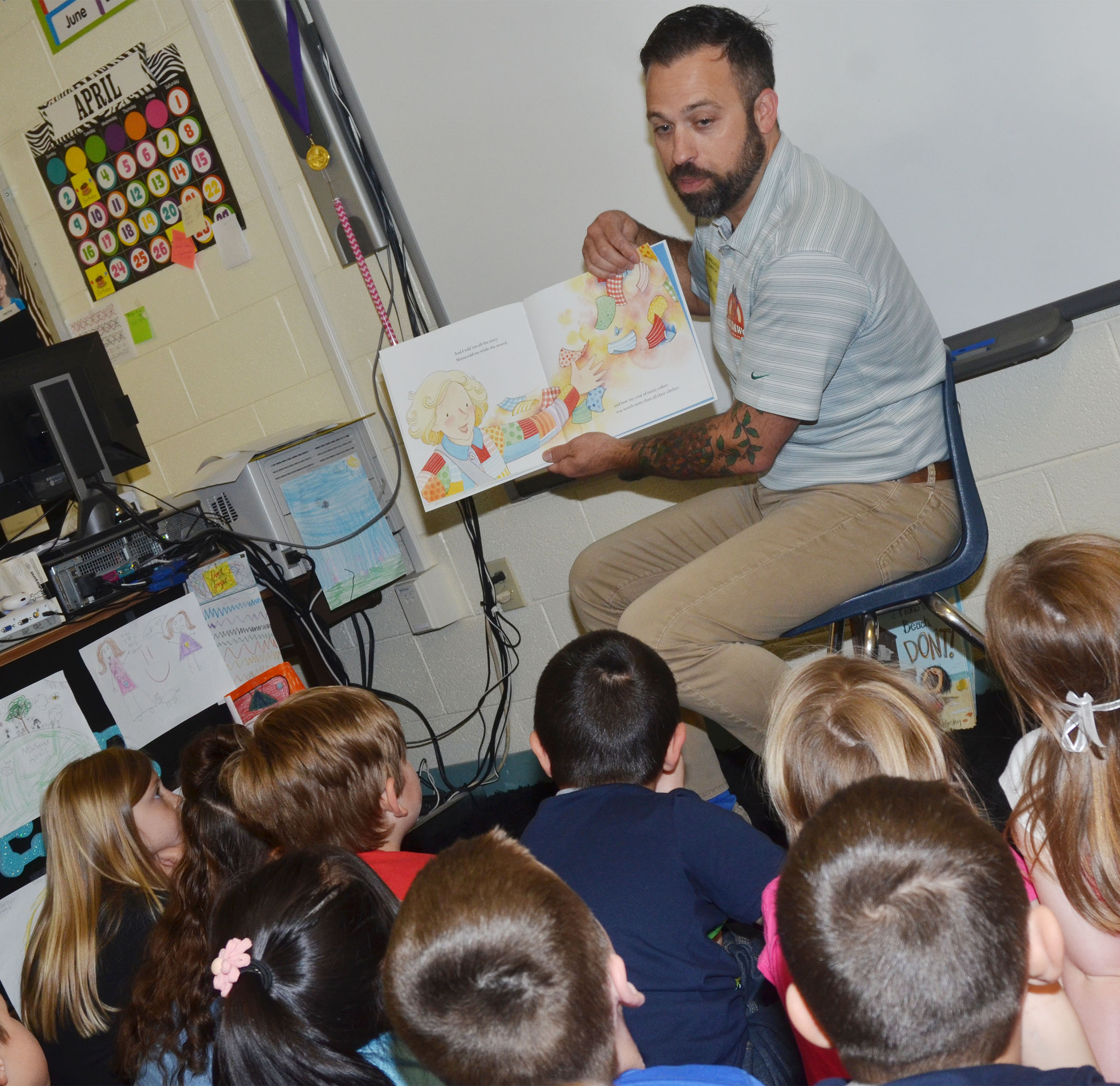 Brent Thompson reads to CES second-graders.